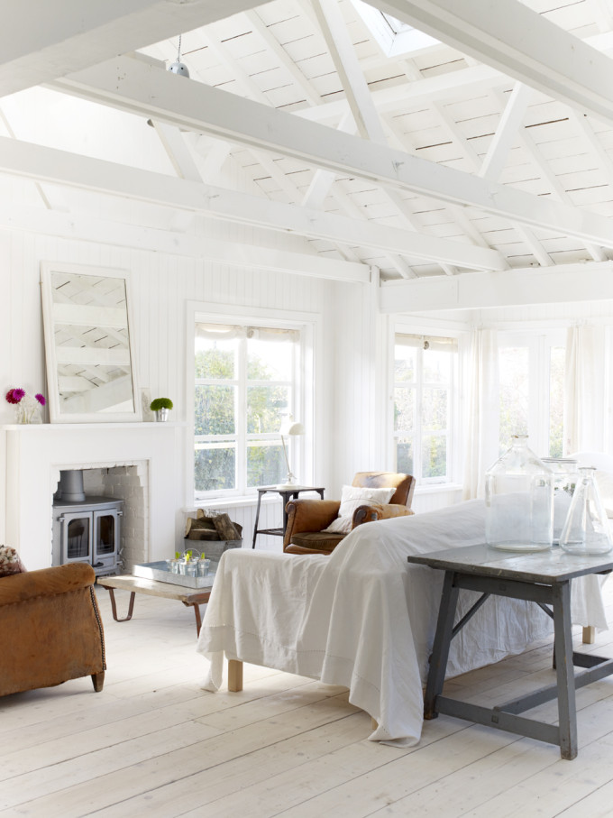 Take a tour of the gorgeous White Cabin in the village of Winchelsea, a beach town in East Sussex, South England. - Living Room Exposed Beams