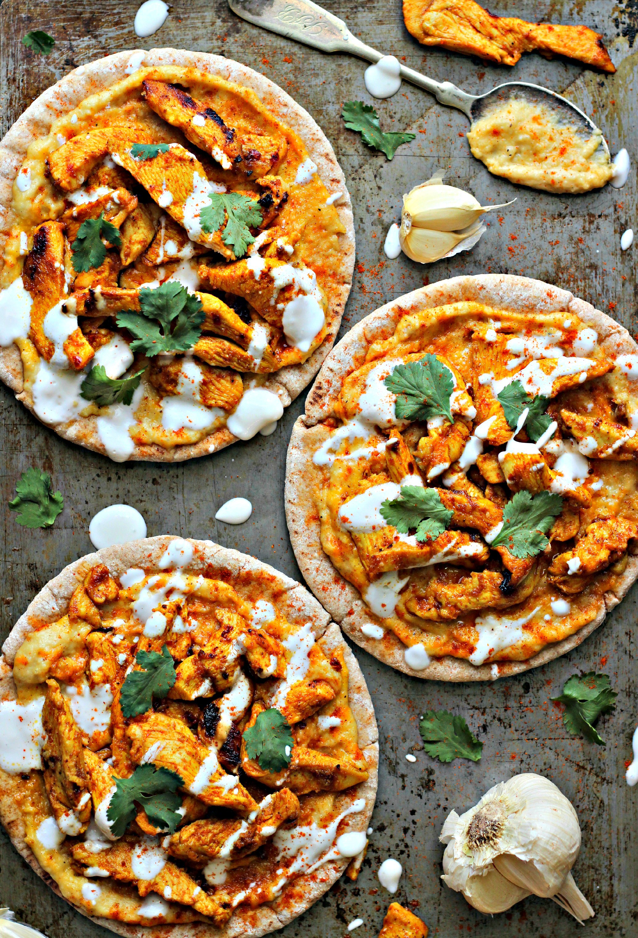 Chicken Shawarma with Hummus on Pita - 20 Amazing Ways to Eat Hummus (that will become instant favorites in your house!) Snuck into sandwiches, a substitute pizza sauce, a base for salad dressing, in soups, chocolate hummus, and even cooked right into pancakes; after scrolling through these recipes you'll be craving hummus like none other. Click through for the recipes.