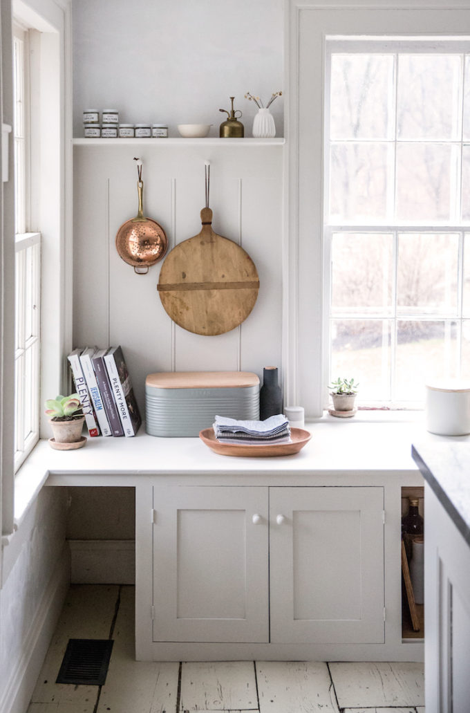 White Kitchen Corner with Copper and Wood Details