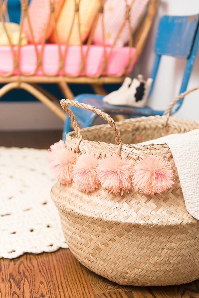 15 Favorite French Market Baskets, like this Pom Pom Basket in a Colorful Flamingo Nursery