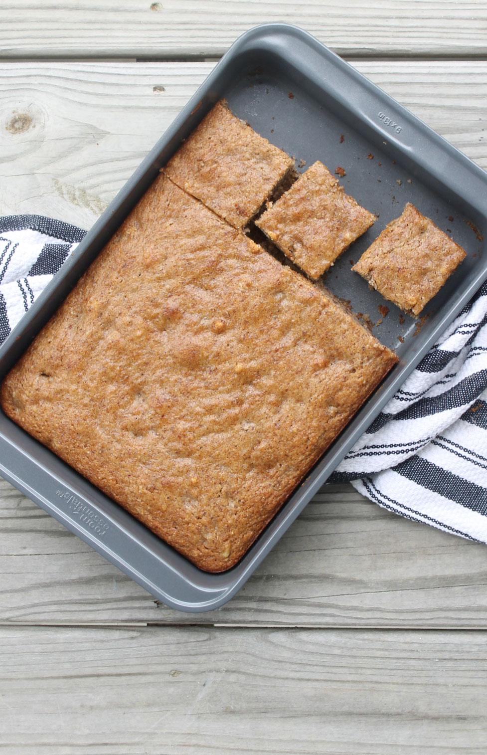 Healthier Vegan Banana Cake With Almond Flour (You'll never be able to tell this moist, fluffy cake doesn't have any dairy or eggs!) Click through for the recipe. #bananabread #bananacake #veganbananabread #vegan #almondflour #healthydessert #healthysnack #healthybananabread | glitterinc.com | @glitterinc