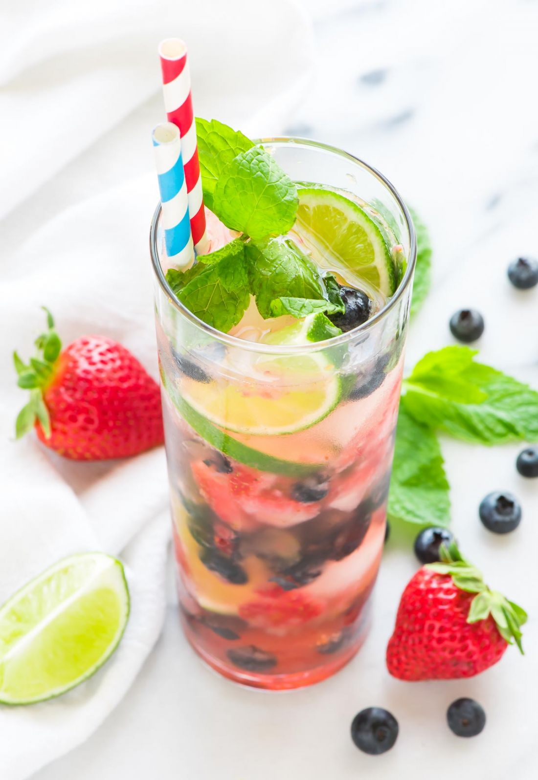 Blueberry Strawberry Mojito (The perfect pairing for Memorial Day Weekend, the 4th of July, or really any weeknight or weekend you want to grill this Summer!)