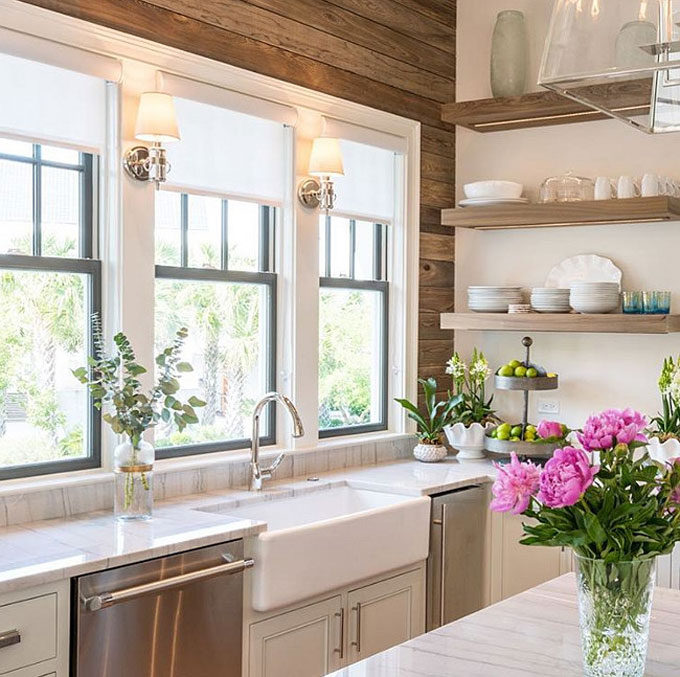 Florating-Shelves.-Kitchen-with-foating-shelves-by-windows-above-farmhouse-sink.-Fruit-tray-is-from-One-Kings-Lane.-Floating-Shelves.-kitchen-floatingshelves-farmhousesink-Old-Seagrove-Homes.