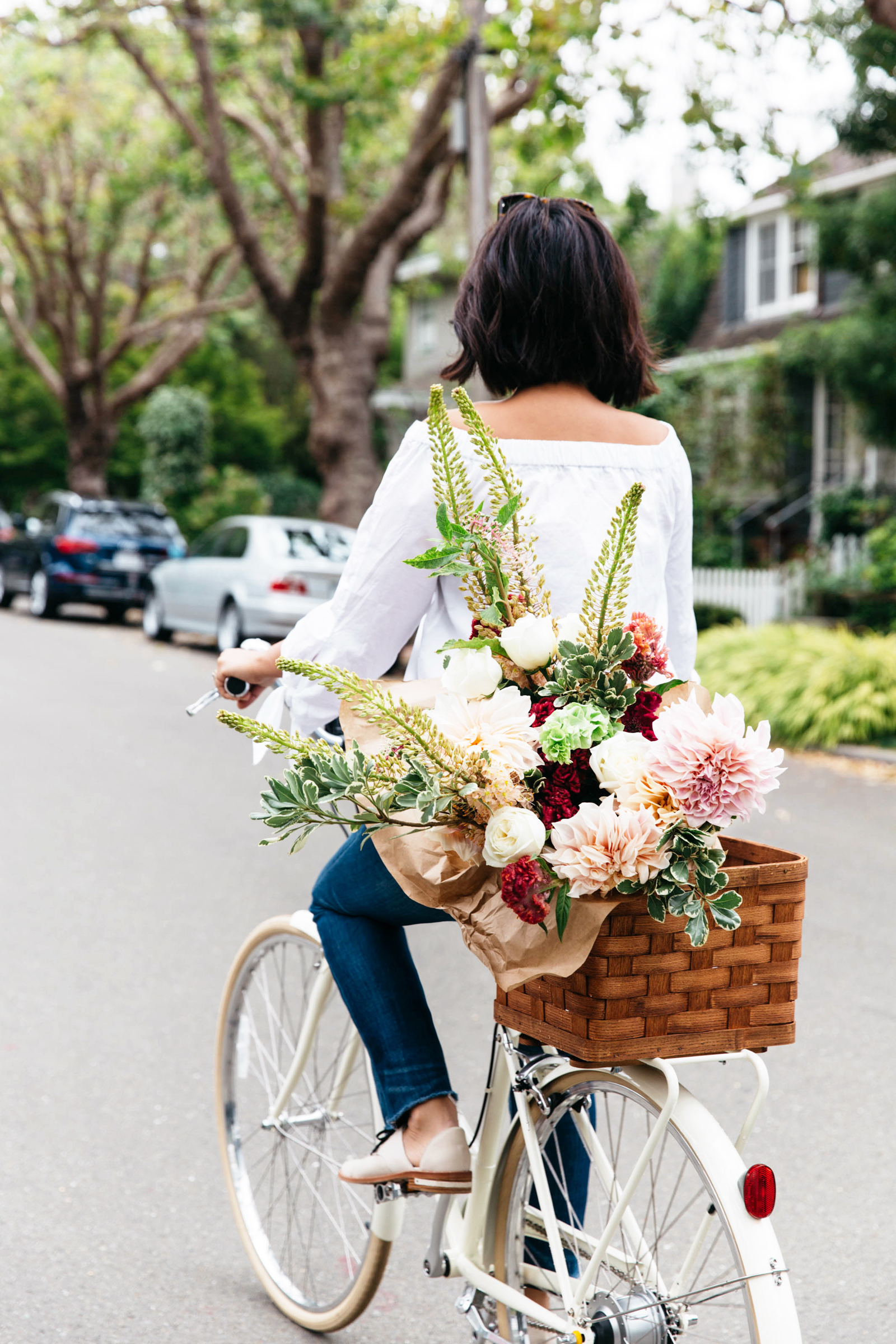 papillionaire bicycle with basket of flowers