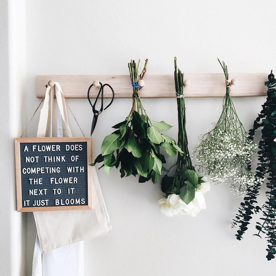 The Coolest Customizable Art: Felt Letter Boards and Black Light Boxes, plus where to buy them. (Flower Felt Letterboard Sign)