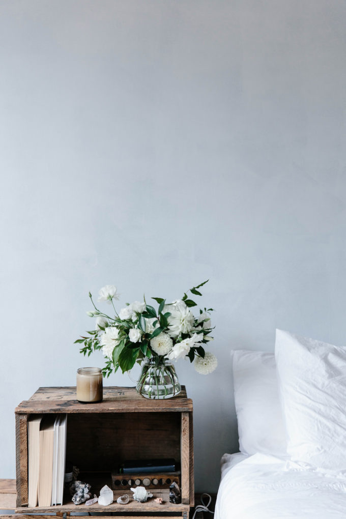 A Simple Way to Brighten Your Bedroom for Summer (beautiful white flowers by the bed)