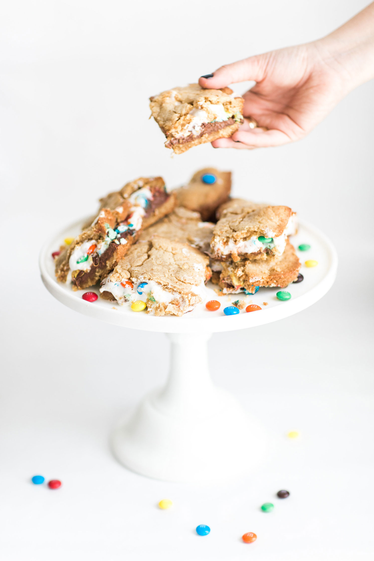 How to Make The Best Ever M&M S'Mores Cookie Bars. (These s'mores bars are moist, perfectly sweet, and taste like your favorite campfire treat!) Click through for the recipe. #smores #smoresbars #dessert | glitterinc.com | @glitterinc