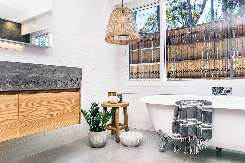 Step inside one very cool bohemian beach home in Australia. (That also happens to be a rental and an event venue!) - Claw-Footed Tub in the Bathroom