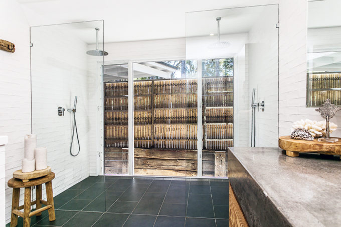 Step inside one very cool bohemian beach home in Australia. (That also happens to be a rental and an event venue!) - Open Shower Bathroom