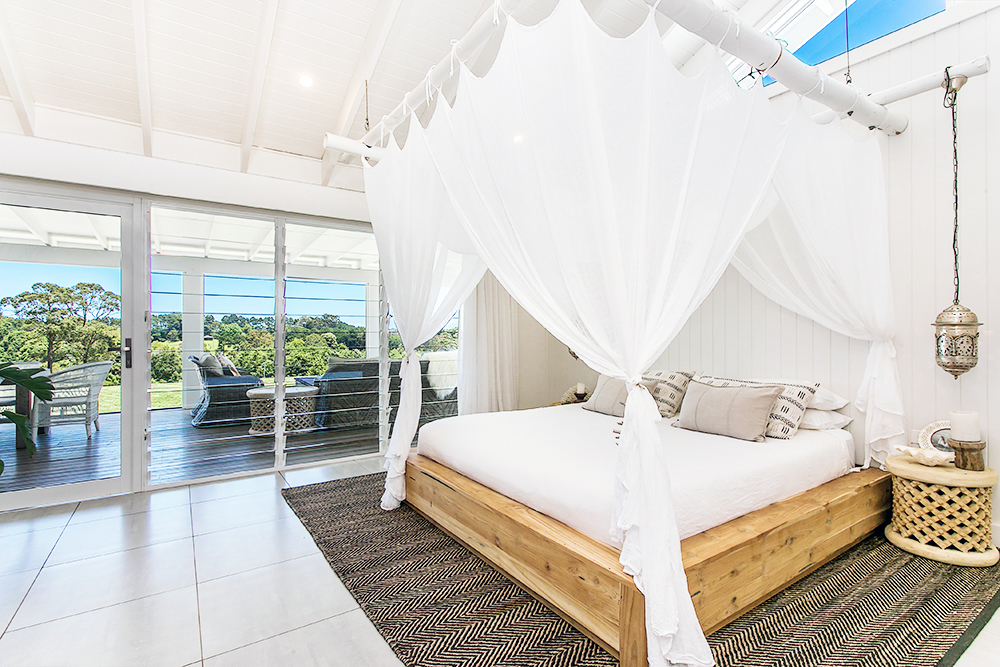 Step inside one very cool bohemian beach home in Australia. (That also happens to be a rental and an event venue!) - Breezy White Beach Bedroom
