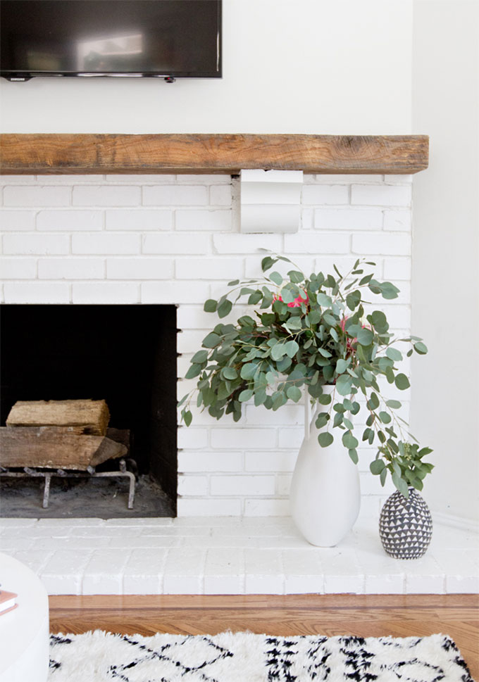 Get Inspired: The DIY White Brick Fireplace (Love this rustic modern version!)