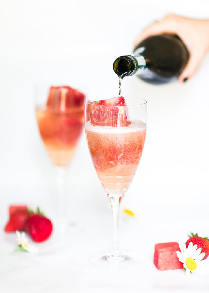 Celebrate summer with oh so refreshing strawberry watermelon Prosecco spritzers! Sparkling Prosecco plus strawberry infused watermelon ice cubes makes for the perfect simple cocktail. GLITTERINC.COM