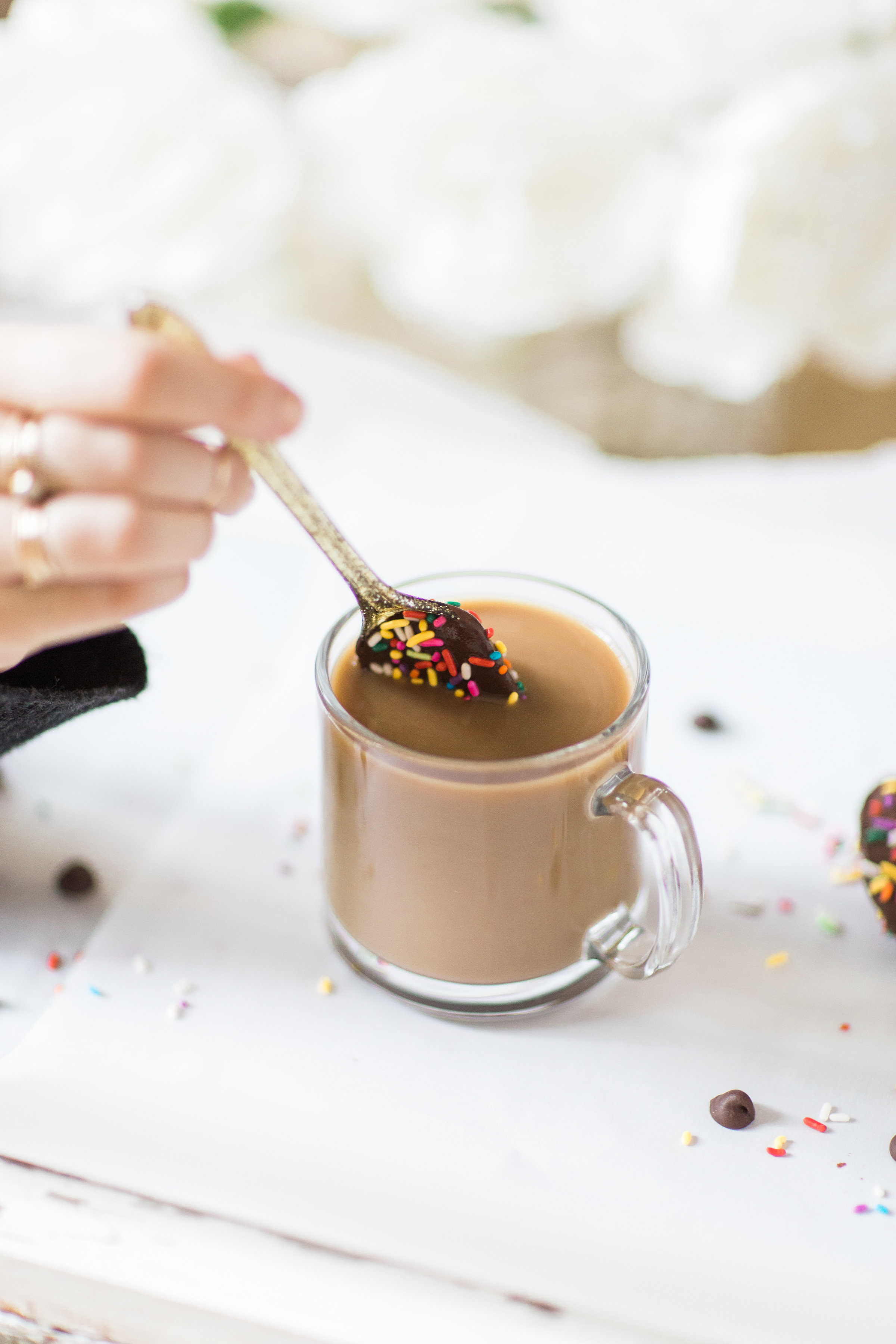 How to make an almond milk chocolate glazed donut coffee with chocolate-dipped sprinkle spoons. Click through for the details. | glitterinc.com | @glitterinc