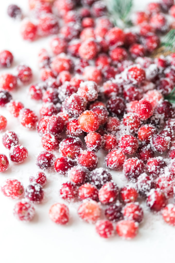 How to make sparkling sugared cranberries for the Holidays that are super simple to make (just two ingredients!) and perfect for dressing up desserts, cheese boards, and cocktails!   glitterinc.com   @glitterinc