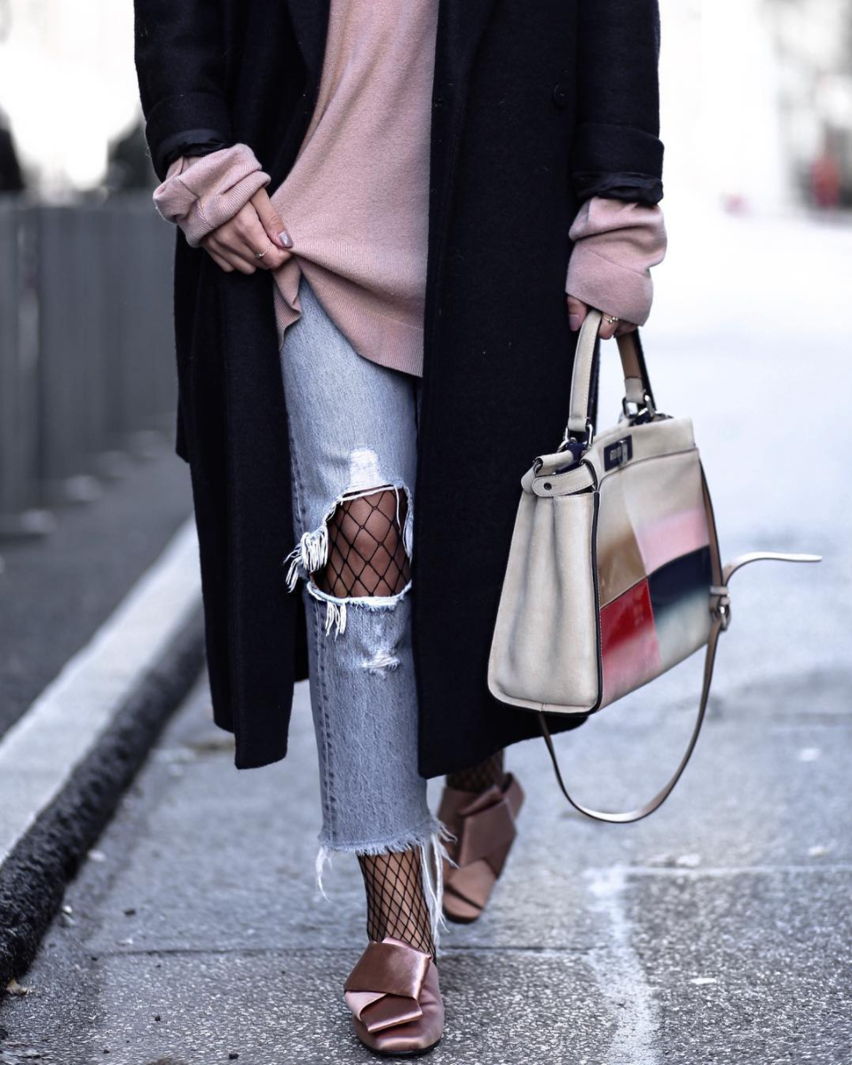 Fishnets under ripped jeans! By the way, Fishnets Are Back: Here are 18 Chic Ways to Wear Them.   glitterinc.com   @glitterinc