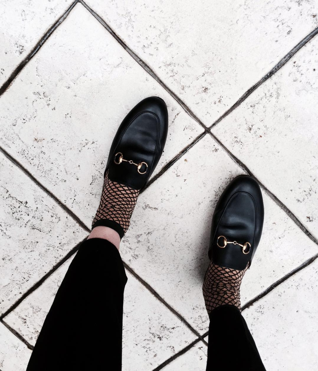Fishnets and the classic Gucci loafers. By the way, Fishnets Are Back: Here are 18 Chic Ways to Wear Them. | glitterinc.com | @glitterinc