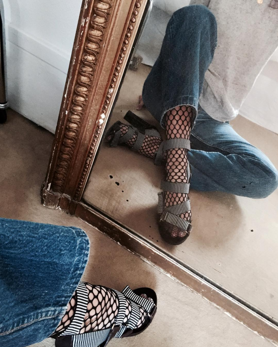 Fishnets, under jeans, and the coolest sandals. By the way, Fishnets Are Back: Here are 18 Chic Ways to Wear Them. | glitterinc.com | @glitterinc