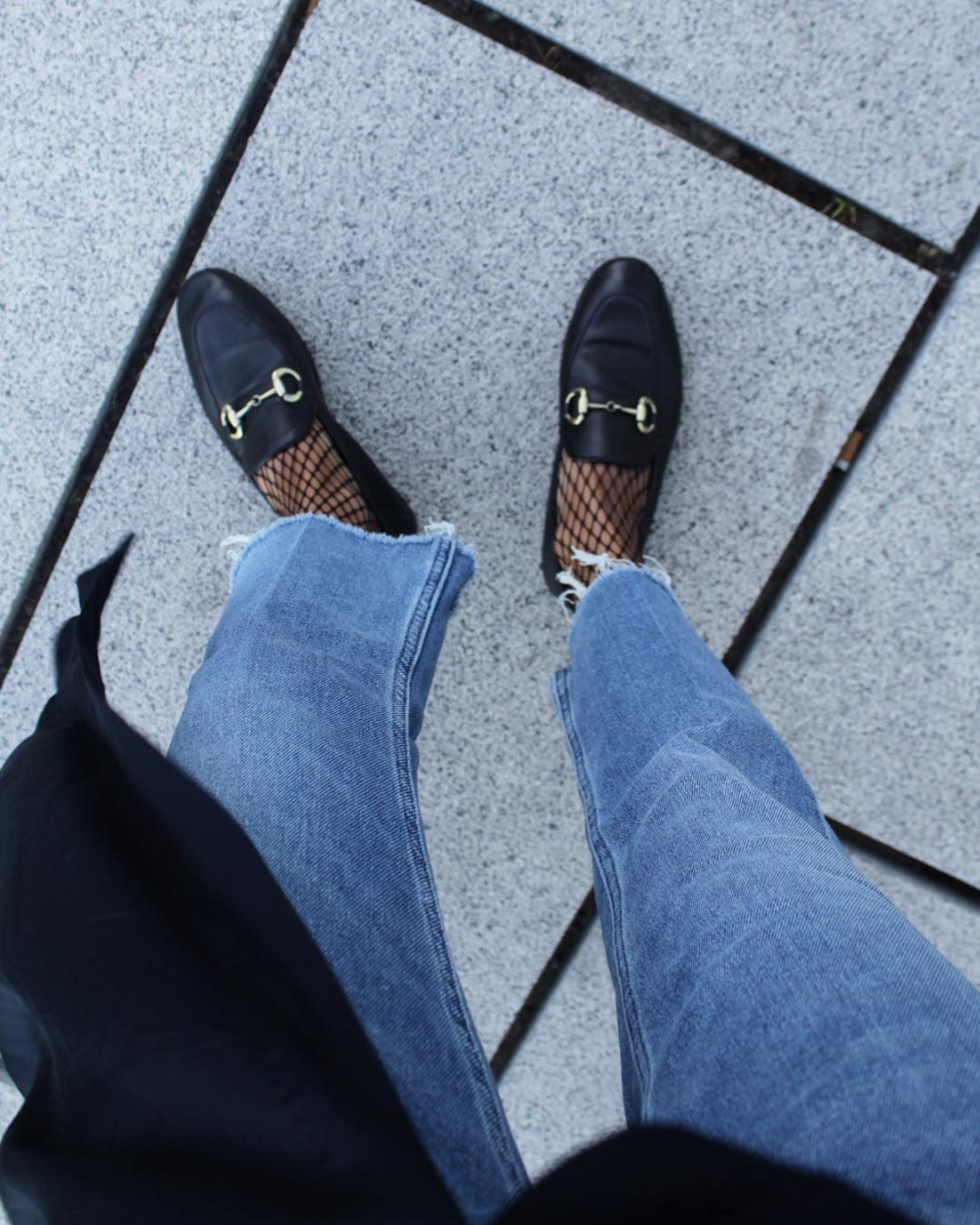 Fishnets under jeans paired with classic loafers. By the way, Fishnets Are Back: Here are 18 Chic Ways to Wear Them.   glitterinc.com   @glitterinc