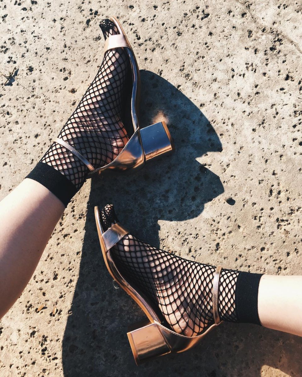 Rose gold metallic sandals and fishnet socks. By the way, Fishnets Are Back: Here are 18 Chic Ways to Wear Them. | glitterinc.com | @glitterinc