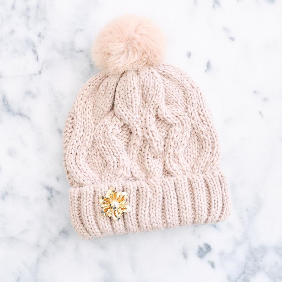 Put a Pin On It: A Brooch That Is (vintage brooch on a winter hat) | Click through for the details. | glitterinc.com | @glitterinc