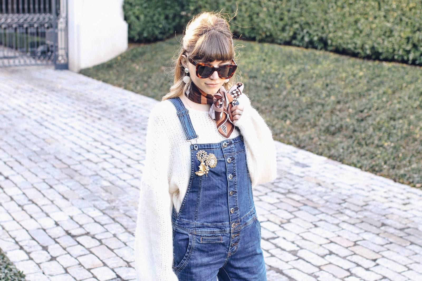 Put a Pin On It: A Brooch That Is (Pearl brooches on denim overalls, sweater, and scarf) | Click through for the details. | glitterinc.com | @glitterinc