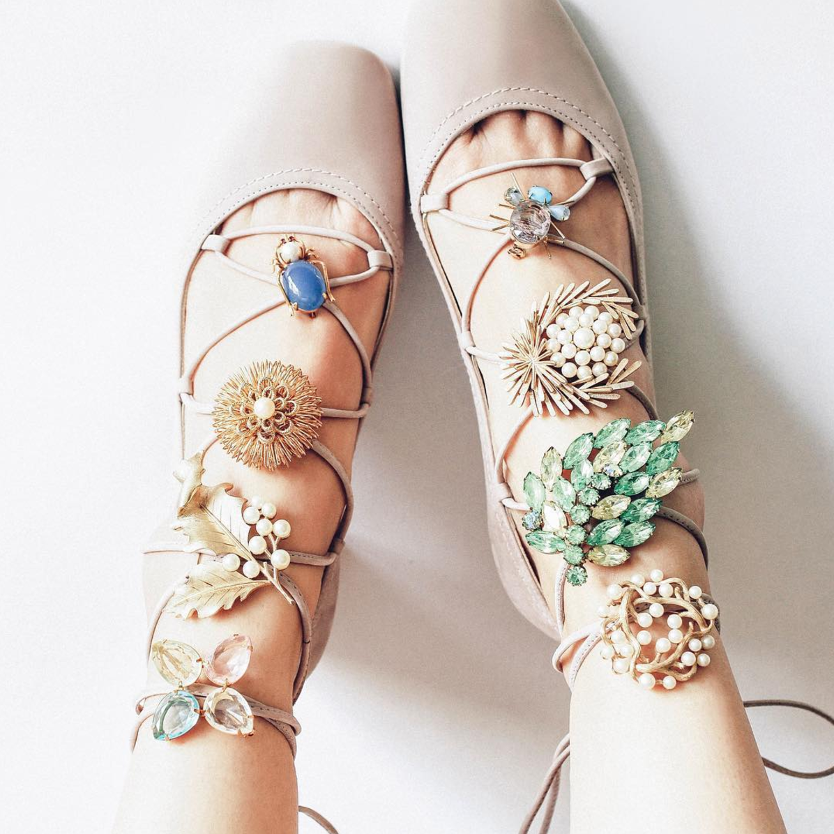 Put a Pin On It: A Brooch That Is (vintage pins on lace-up shoes) | Click through for the details. | glitterinc.com | @glitterinc