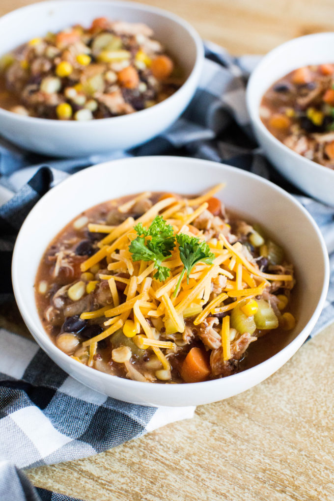 This amazing slow cooker (crockpot or instant pot) chicken vegetable and quinoa soup is healthy and hearty and requires so little work it's kind of embarrassing. Click through for the recipe. | glitterinc.com | @glitterinc