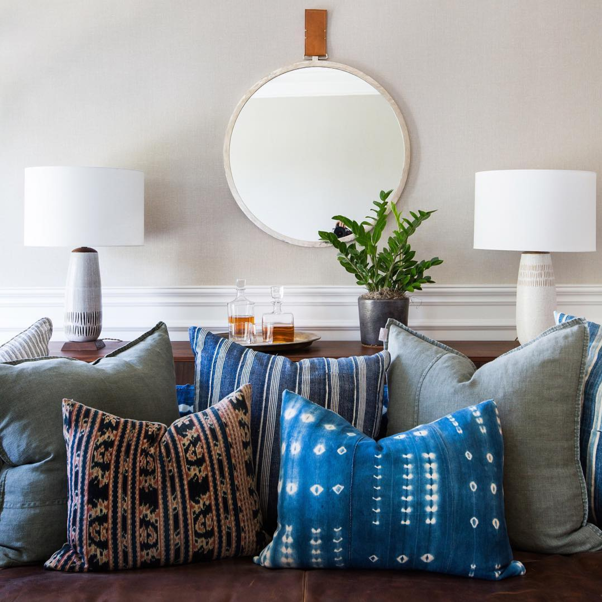 Living Room with Blue Dyed Pillows and Round Mirror (Plus, where to find the Round Mirror at every price + why they look so great in every space!) Click through for the details. | glitterinc.com | @glitterinc