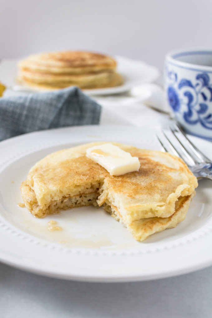 Delicious Lemon Ricotta Pancakes by foodie blogger Lexi of Glitter, Inc. Click through for the recipe. | glitterinc.com | @glitterinc