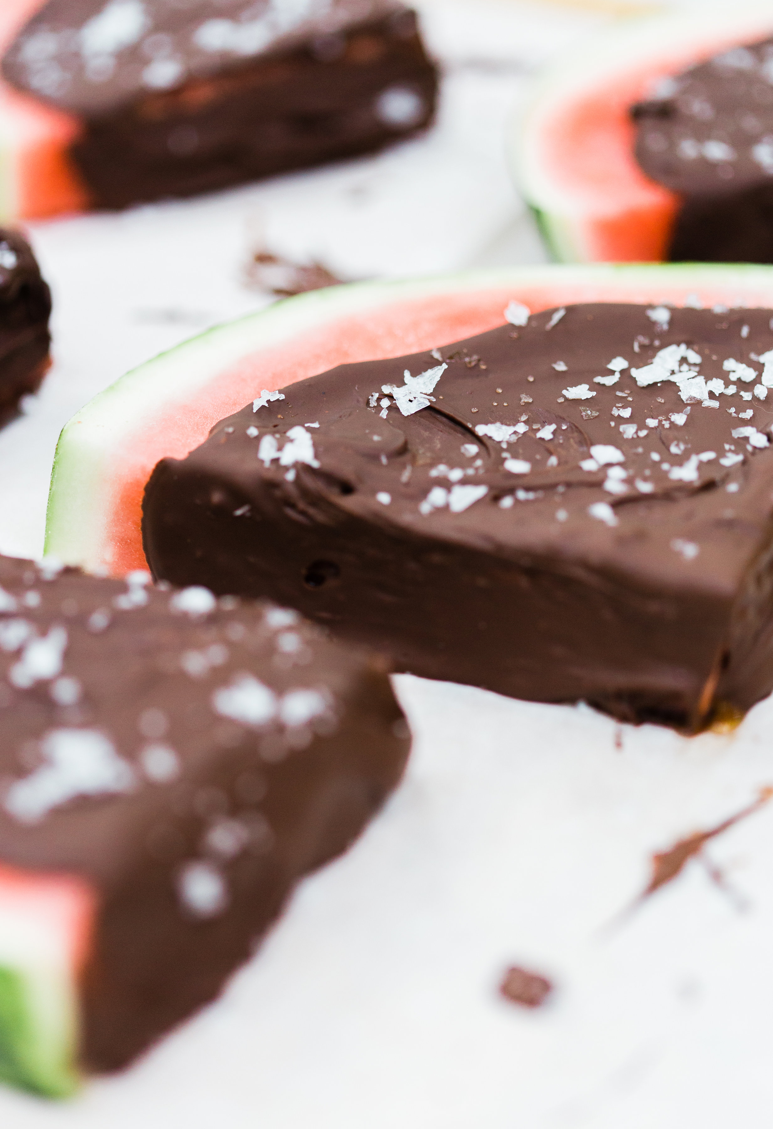 Salted Dark Chocolate Watermelon Slices by lifestyle blogger Lexi of Glitter, Inc. Click through for the perfect summer recipe. | glitterinc.com | @glitterinc
