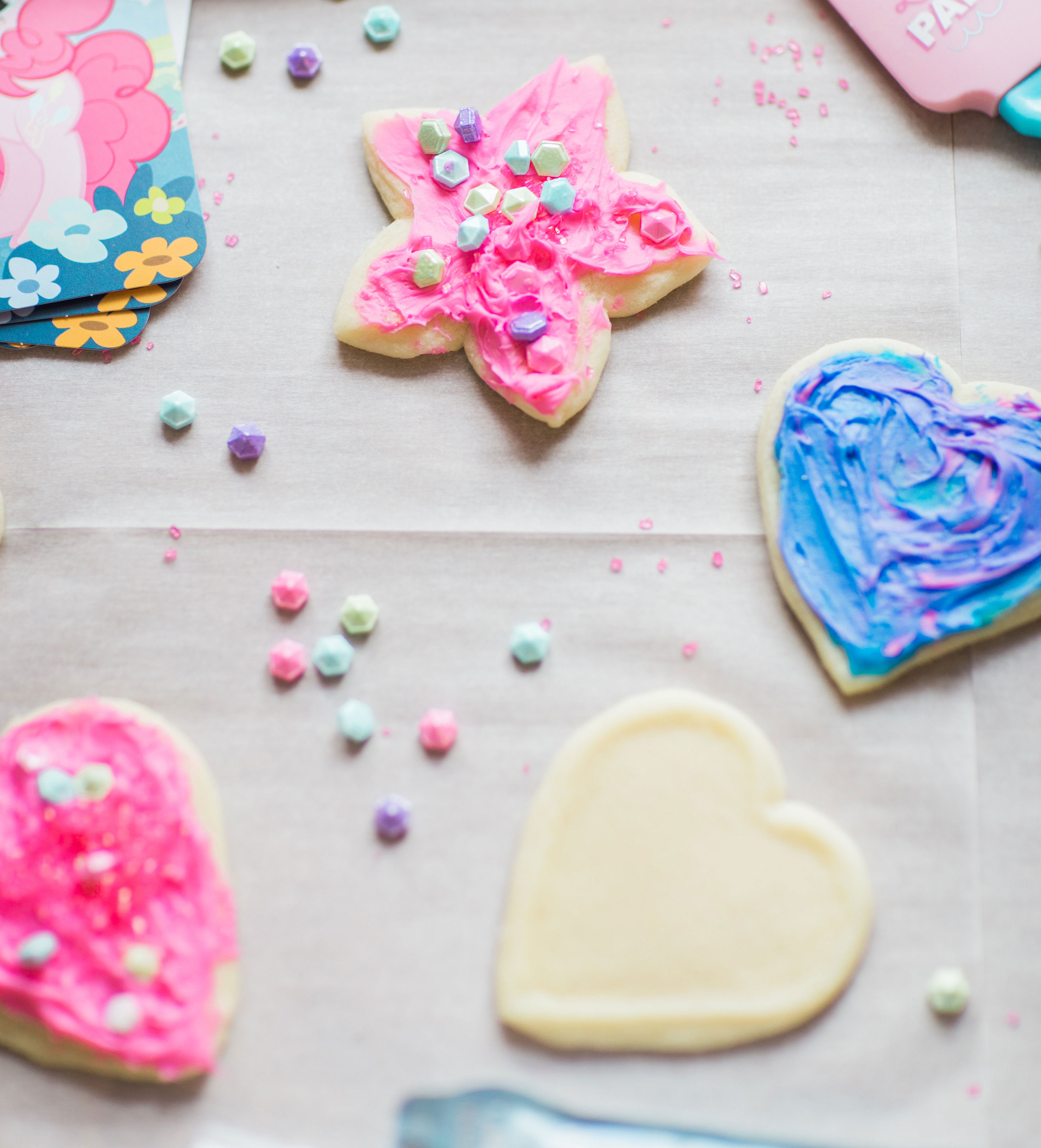 Lifestyle blogger Lexi of Glitter, Inc. shares how to throw your own My Little Pony Party: complete with a cookie decorating station. | glitterinc.com | @glitterinc
