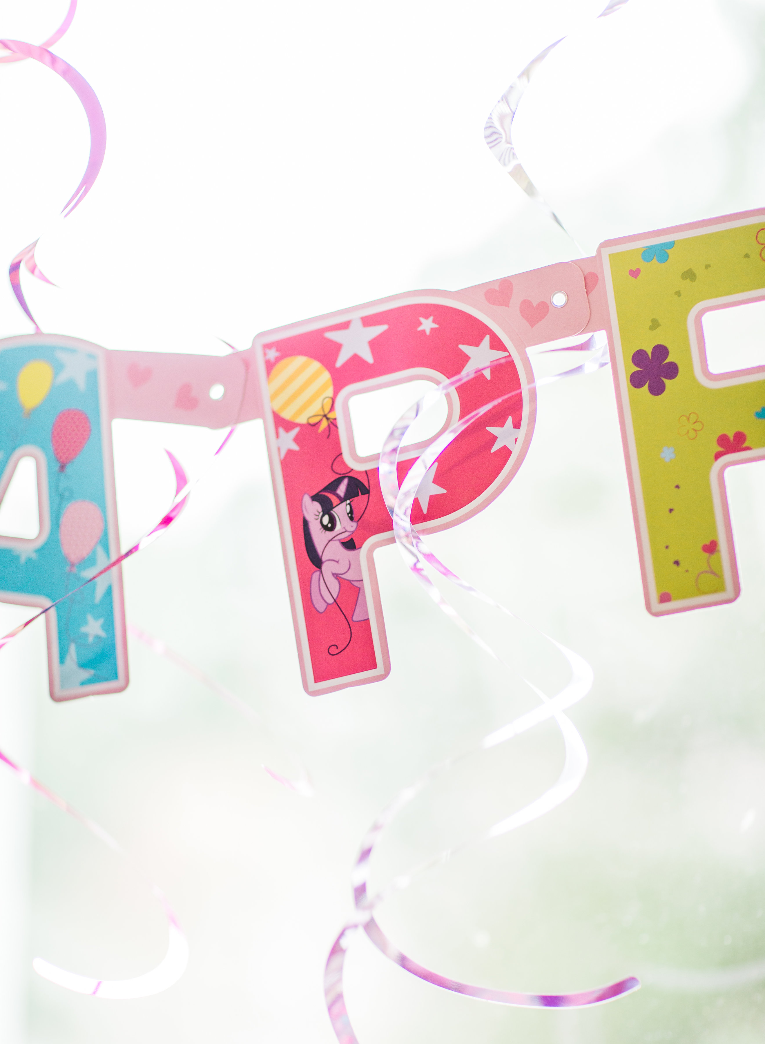 Lifestyle blogger Lexi of Glitter, Inc. shares how to throw your own My Little Pony Party: complete with a cookie decorating station.   glitterinc.com   @glitterinc