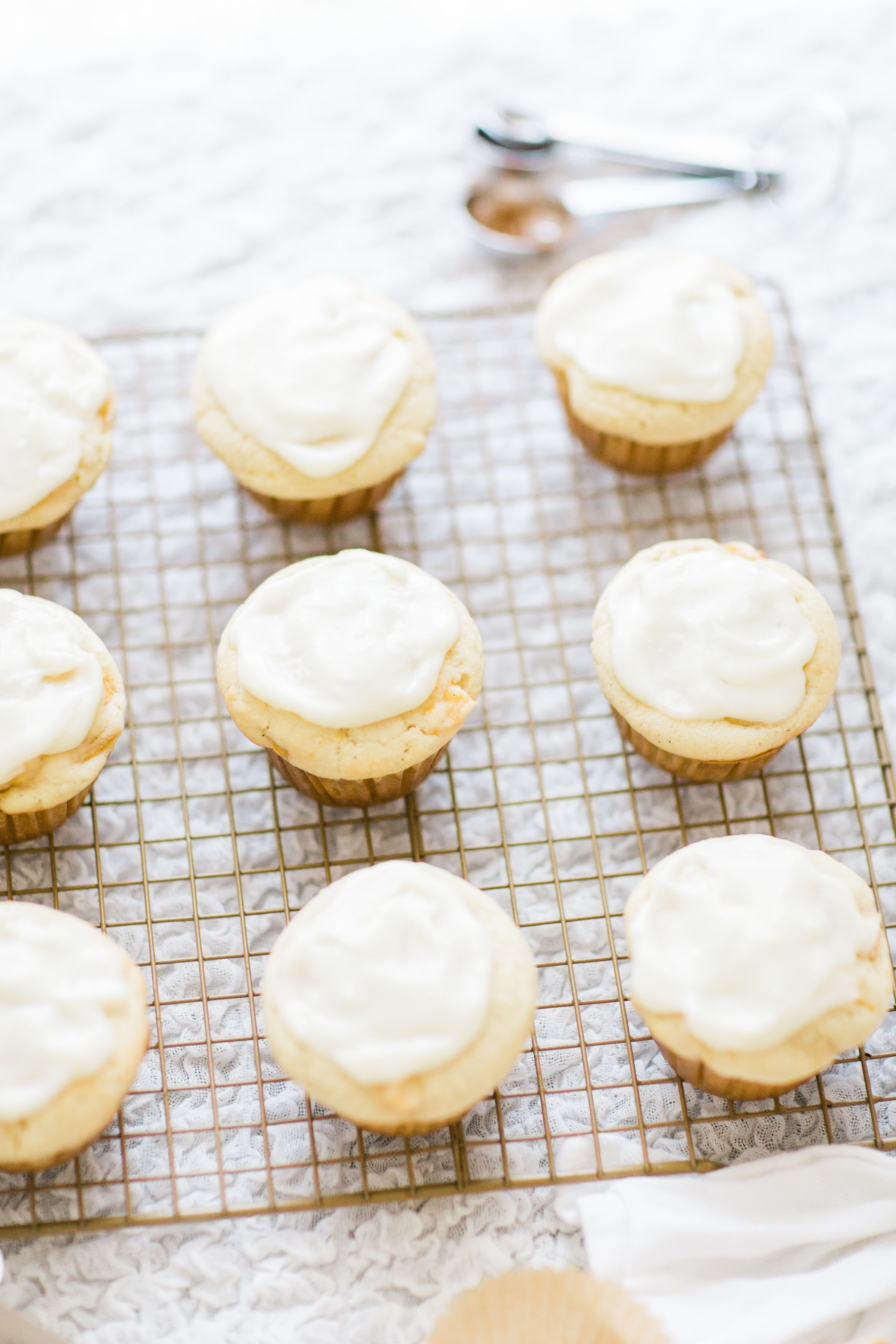 Lifestyle blogger Lexi of Glitter, Inc. shares her recipe for heavenly peaches and cream muffins with decadent cream cheese frosting. | glitterinc.com | @glitterinc
