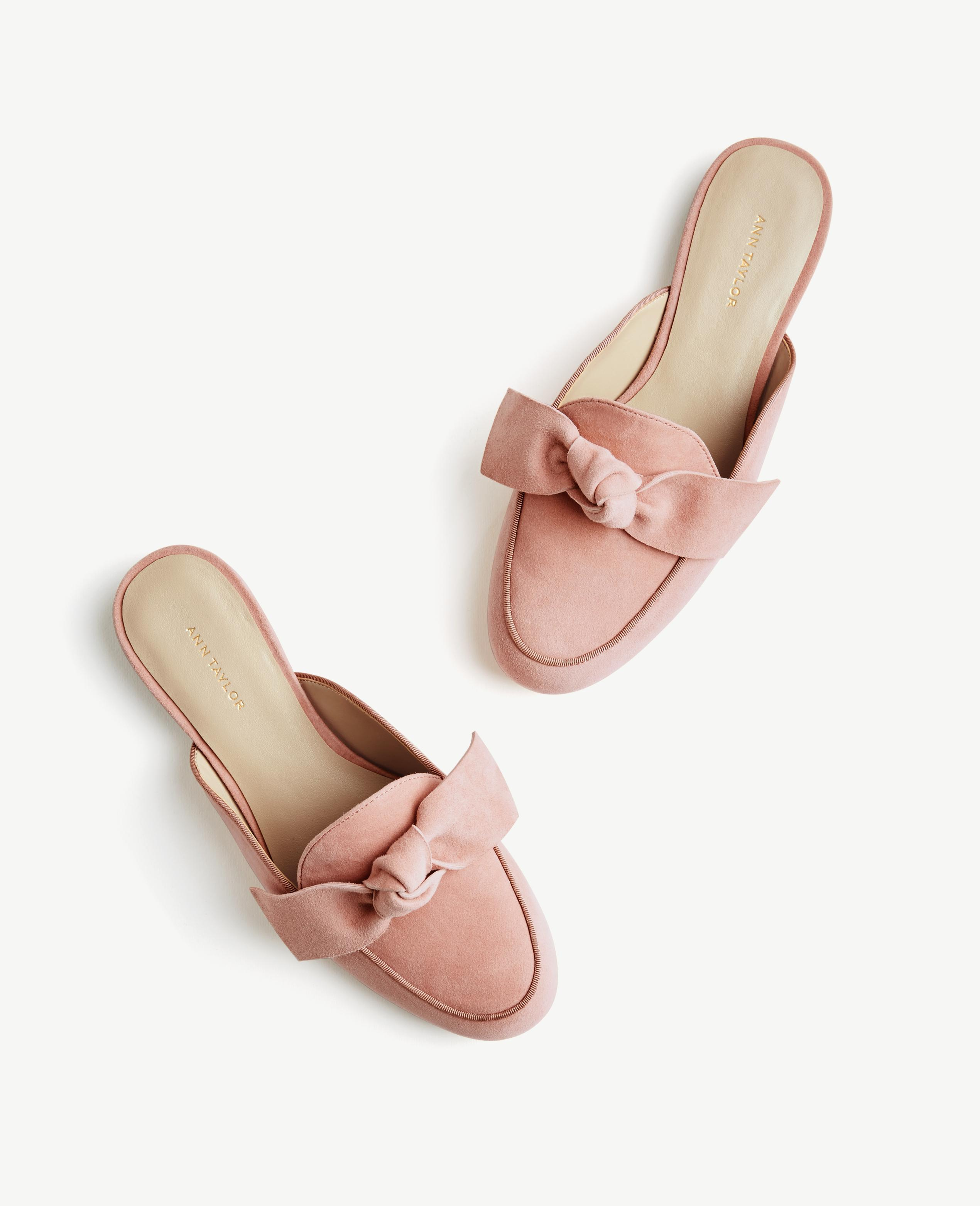 The season of stylish flats is here! Fall shoe love: Ann Taylor Siena Suede Bow Loafer Slides | glitterinc.com | @glitterinc - 15 Trendy Flats To Fall in Love With This Season by NC style blogger Glitter, Inc.