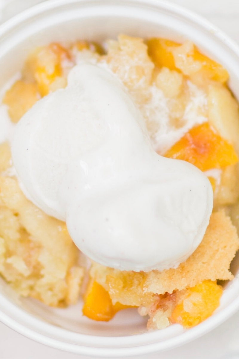This classic peach cobbler is everything an amazing homemade fruit cobbler should be: gooey fresh fruit filling, topped with a layer of moist, buttery, doughy cobbler. If you are on the hunt for the perfect peach cobbler this is it! Click through for the recipe. | glitterinc.com | @glitterinc
