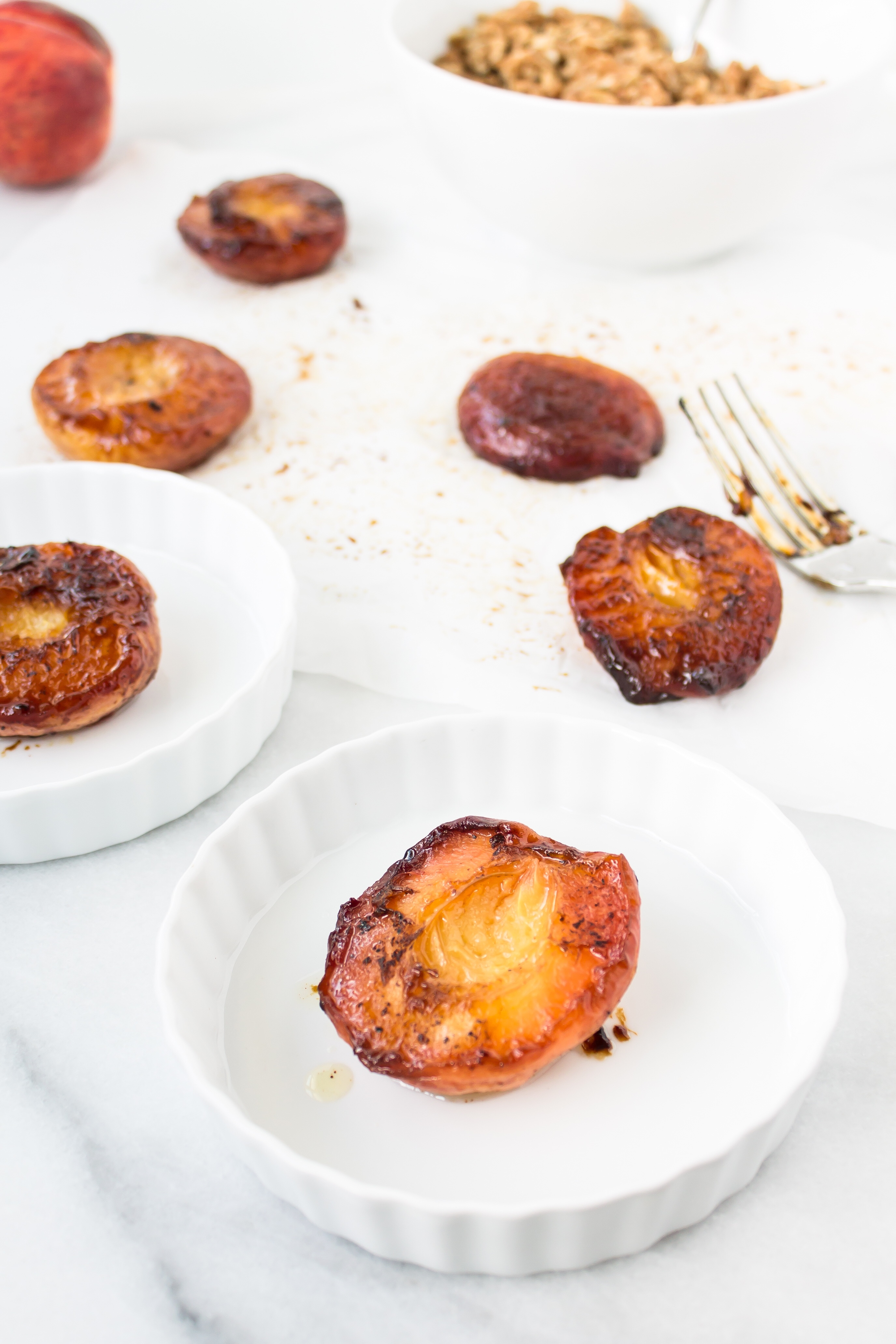 Foodie blogger Lexi of Glitter, Inc. shares the most incredible caramely roasted peaches with yogurt and homemade streusel. Click through for the recipe. | glitterinc.com | @glitterinc
