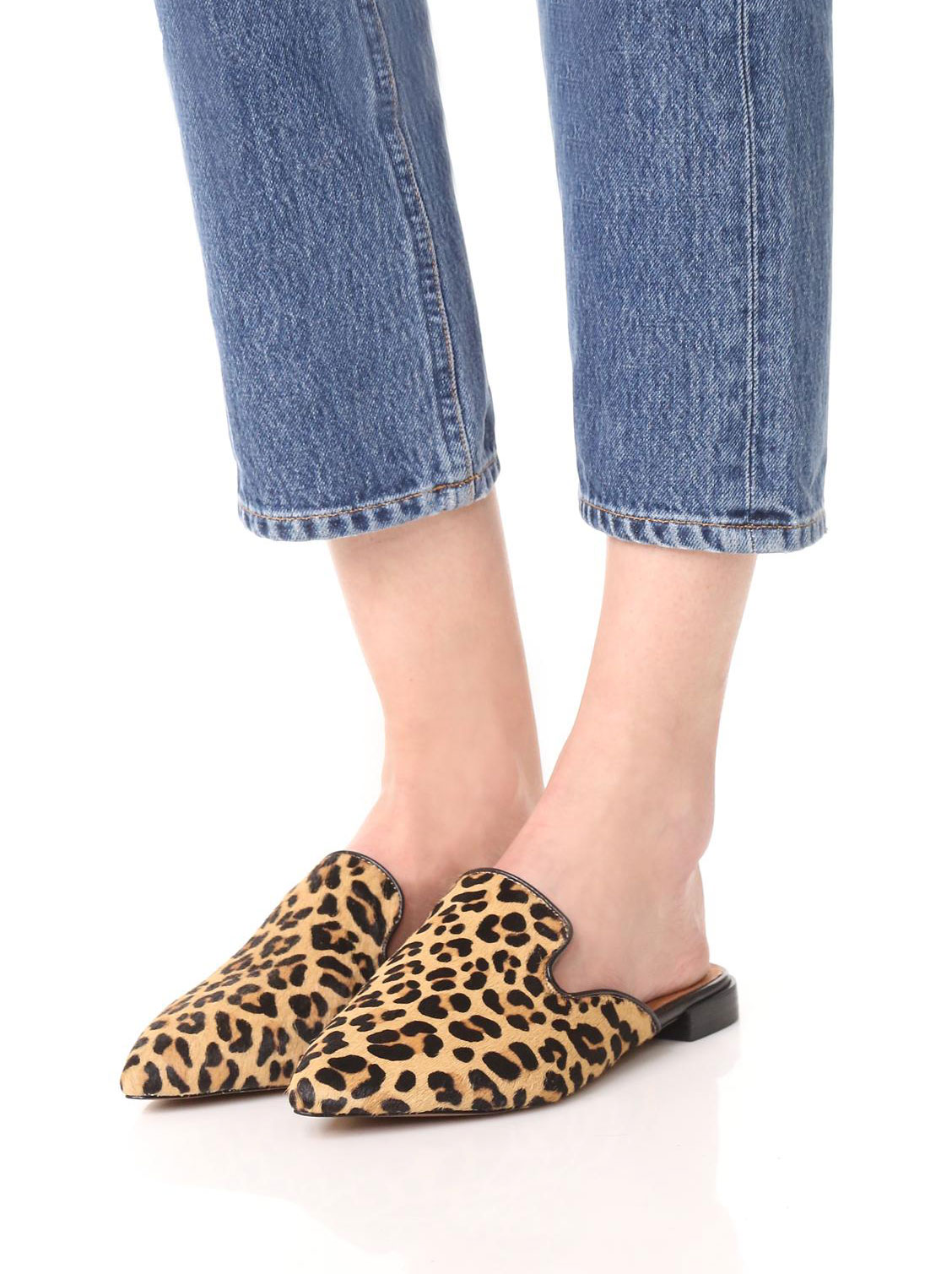 The season of stylish flats is here! Fall shoe love: Steven by Steve Madden Valent Leopard Haircalf Mules | glitterinc.com | @glitterinc - 15 Trendy Flats To Fall in Love With This Season by NC style blogger Glitter, Inc.