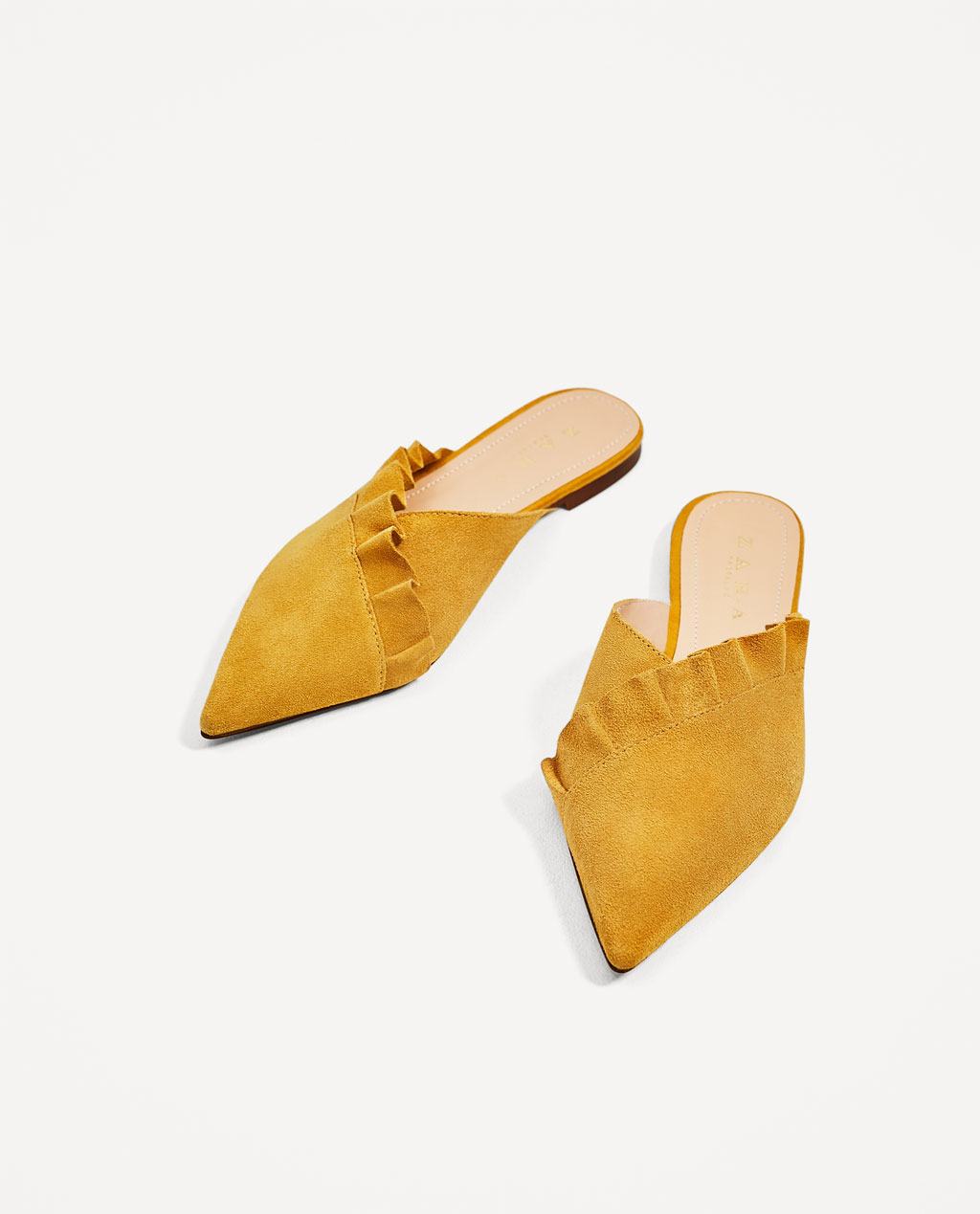 The season of stylish flats is here! Fall shoe love: Zara Leather Mules With Frill | glitterinc.com | @glitterinc
