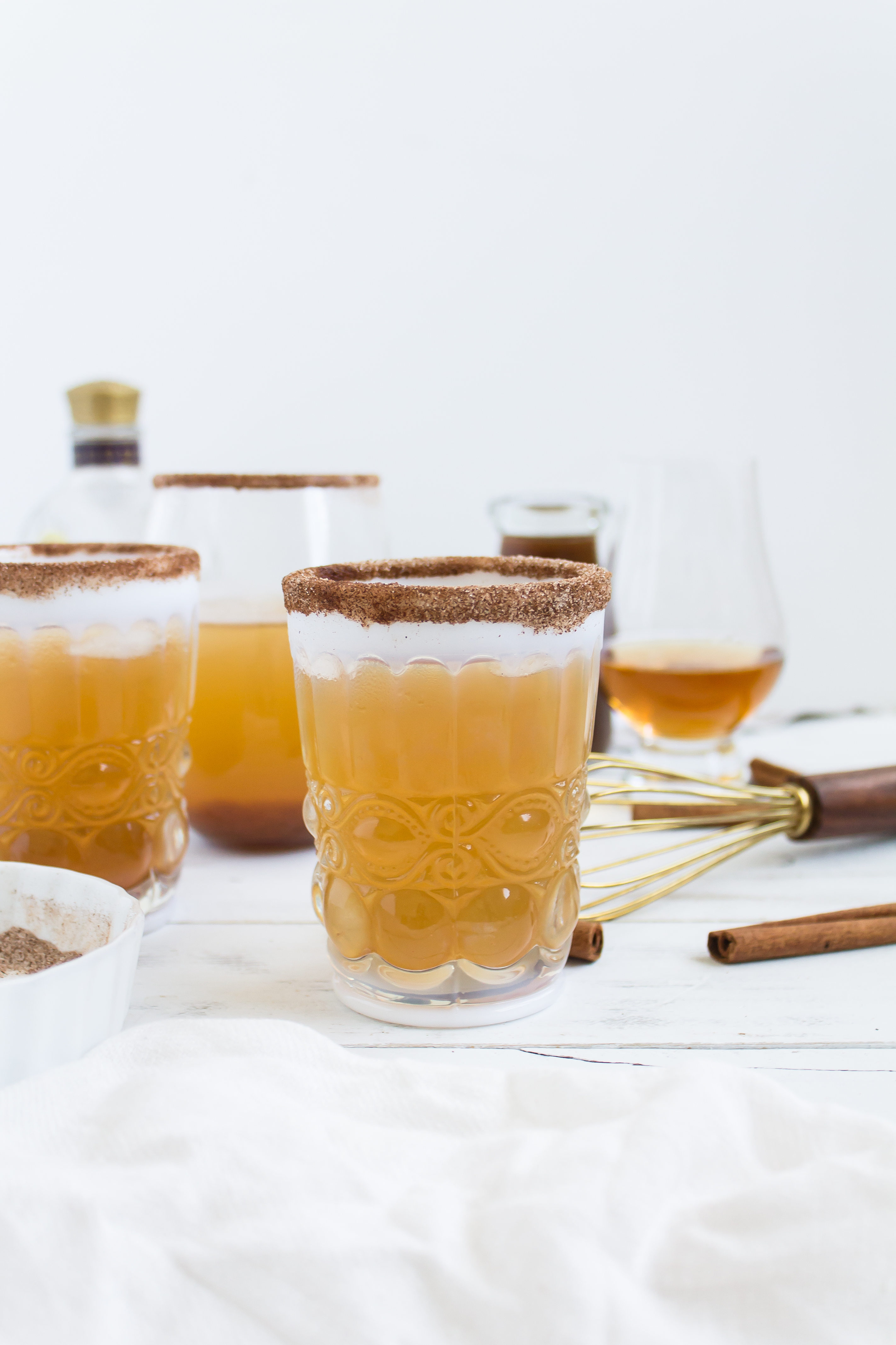 Foodie blogger Lexi of Glitter, Inc. shares a perfect fall cocktail recipe, and spin on a classic Kentucky Mule, combining homemade pumpkin ginger simple syrup, smooth bourbon, and spicy ginger beer, ideal for Halloween and Thanksgiving. | glitterinc.com | @glitterinc - Pumpkin Ginger Bourbon Punch Cocktail by North Carolina foodie blogger Glitter, Inc.
