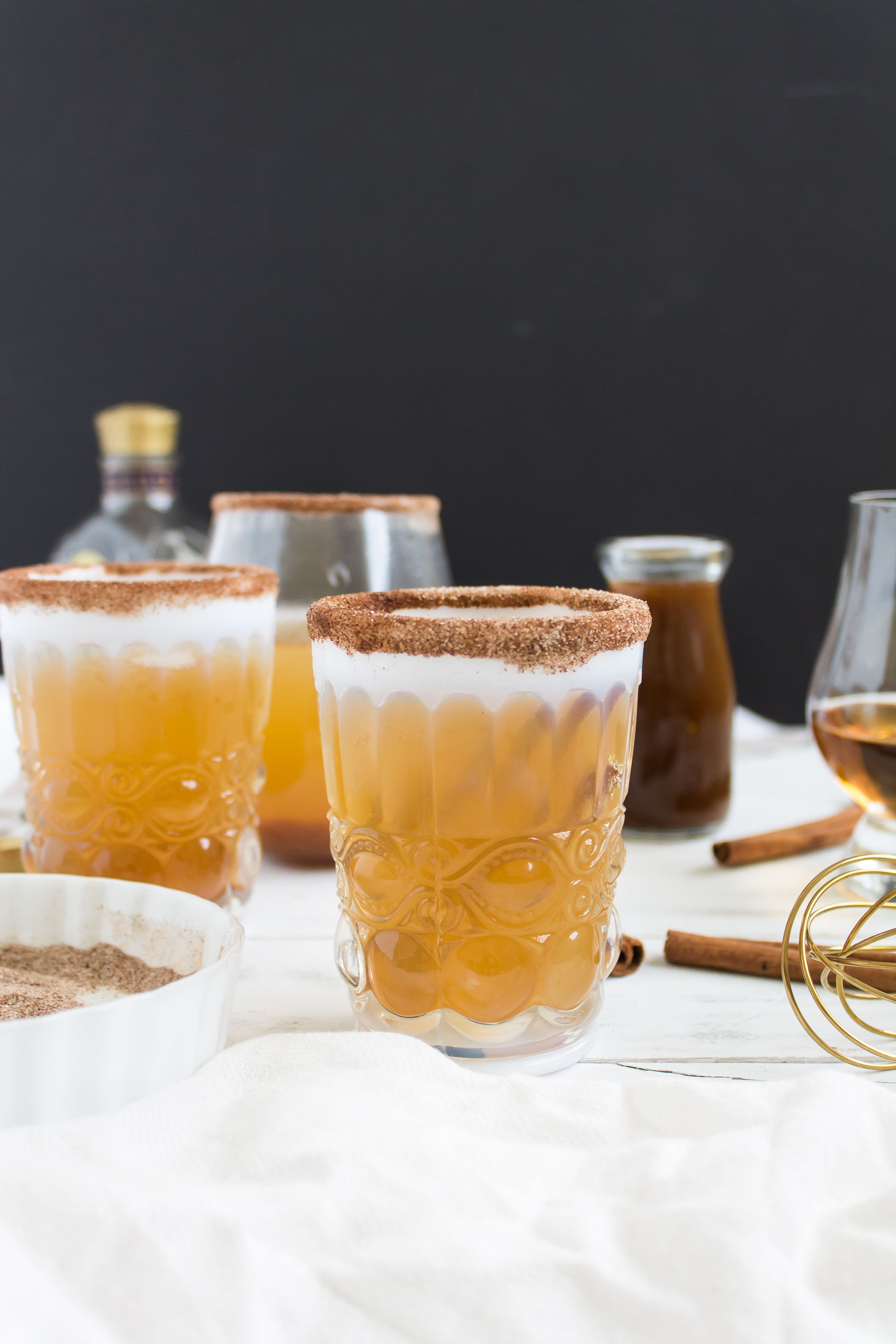 Foodie blogger Lexi of Glitter, Inc. shares a perfect fall drink recipe, and spin on a classic Kentucky Mule, combining homemade pumpkin ginger simple syrup, smooth bourbon, and spicy ginger beer, ideal for Halloween and Thanksgiving. | glitterinc.com | @glitterinc - Pumpkin Ginger Bourbon Punch Cocktail by North Carolina foodie blogger Glitter, Inc.