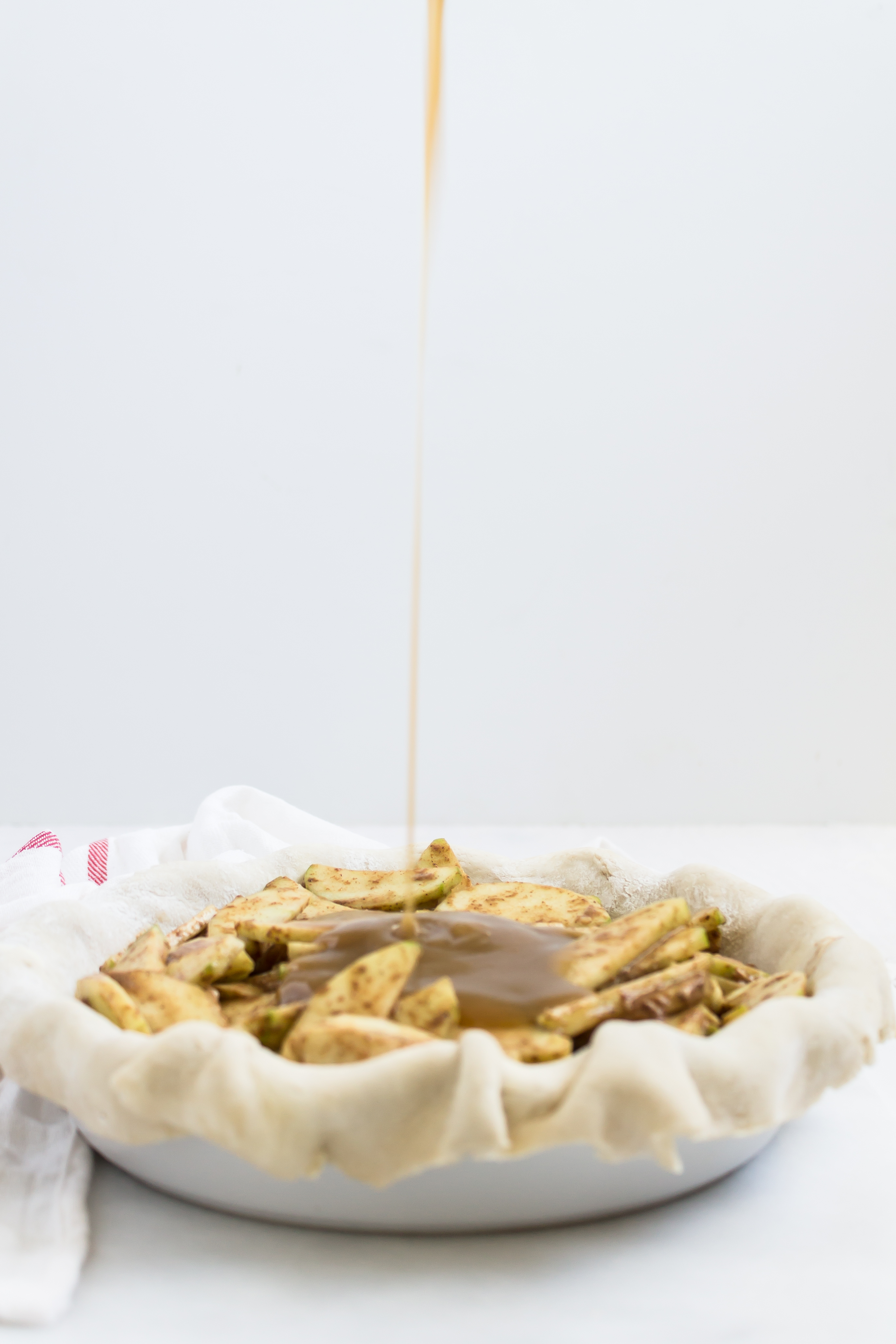Prepare to FREAK out over this spin on a more traditional apple pie drizzled with warm homemade salted maple caramel sauce. Click through for the recipe. | glitterinc.com | @glitterinc