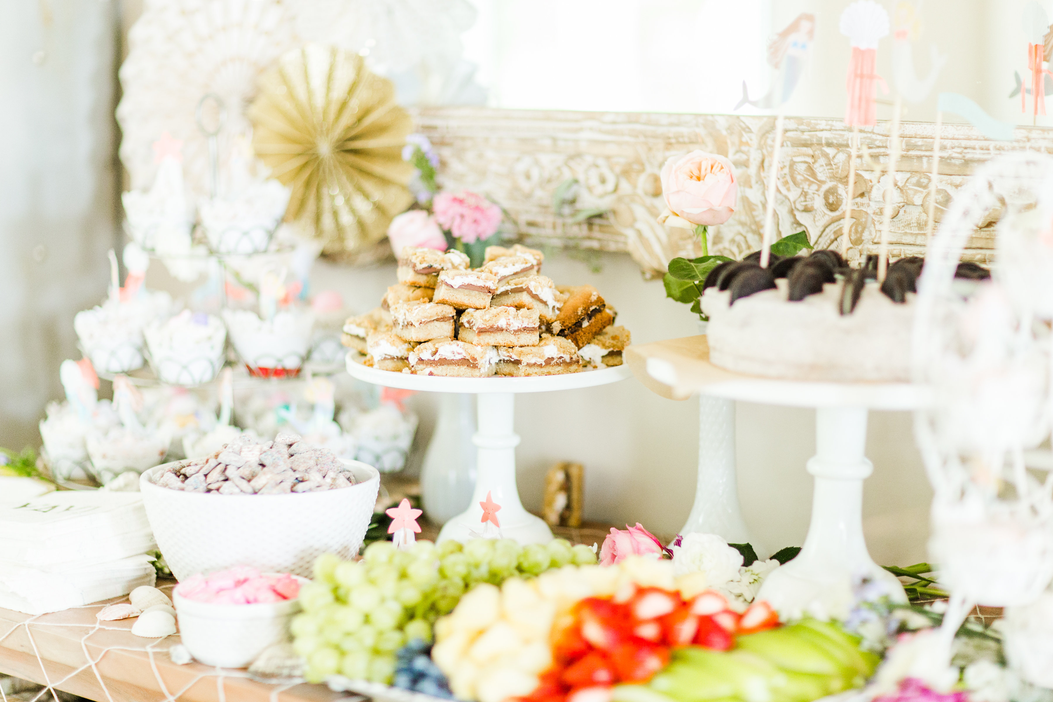 Behind-the-scenes of a magical, whimsical little girl's mermaid birthday party, complete with mermaid dessert bar, games, prizes, and crafts. Click through for the details. | glitterinc.com | @glitterinc