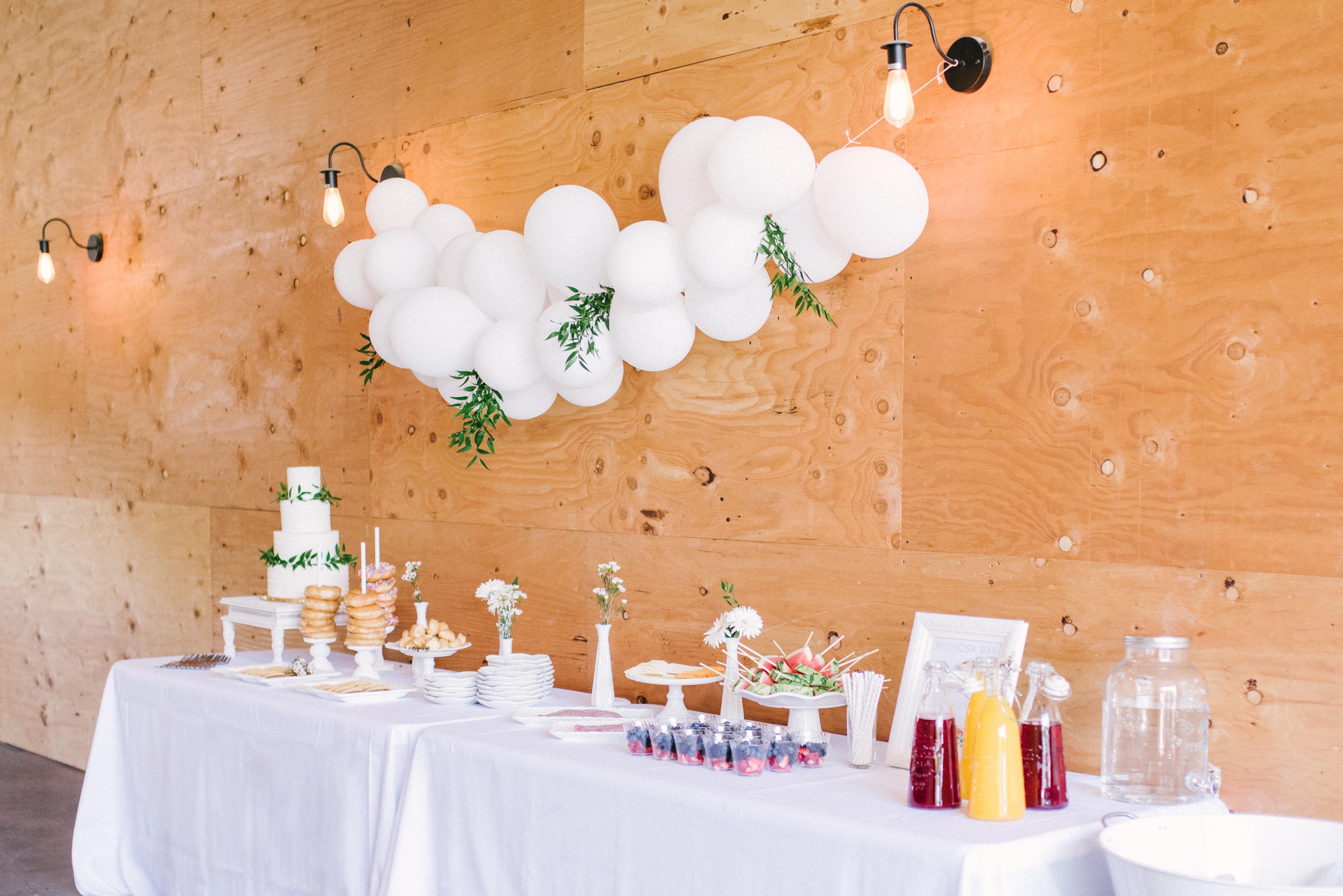 Lovely modern minimalist blush baby shower, set in the coolest industrial farmhouse barn. | glitterinc.com | Hovering Heart Photography | @glitterinc - Modern Minimalist Blush Baby Shower by popular North Carolina style blogger Glitter, Inc.