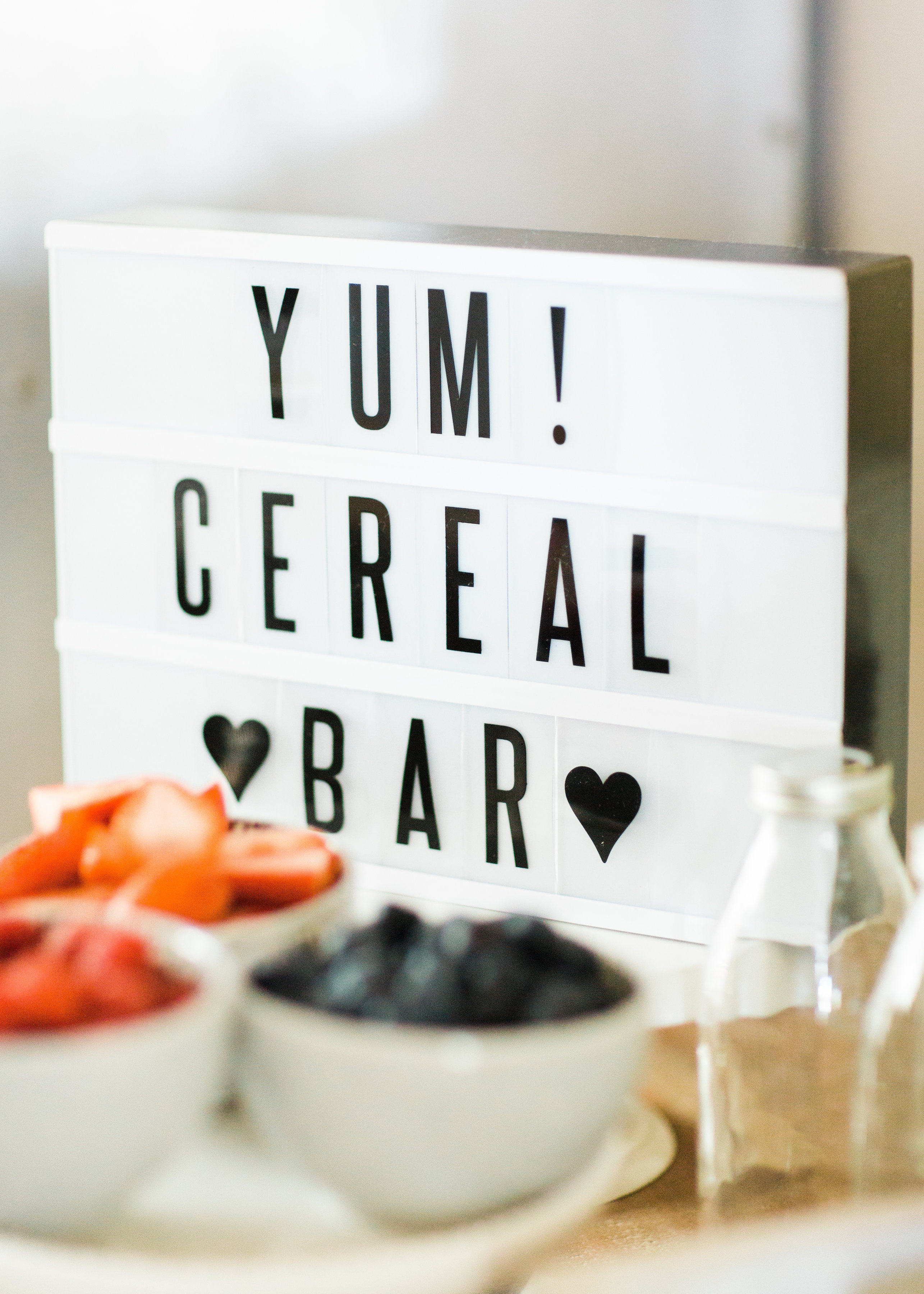 Looking for a unique and easy party dessert station? We're showing you how to put together a DIY retro cereal bar; perfect for a festive and memorable brunch, throwback party, pajama-themed soirée, or sleepover for your kids and their friends! Click through for the details. #brunch #brunchideas #cerealbar #cerealstation #party #partyideas #sleepoverparty #pajamaparty | glitterinc.com | @glitterinc