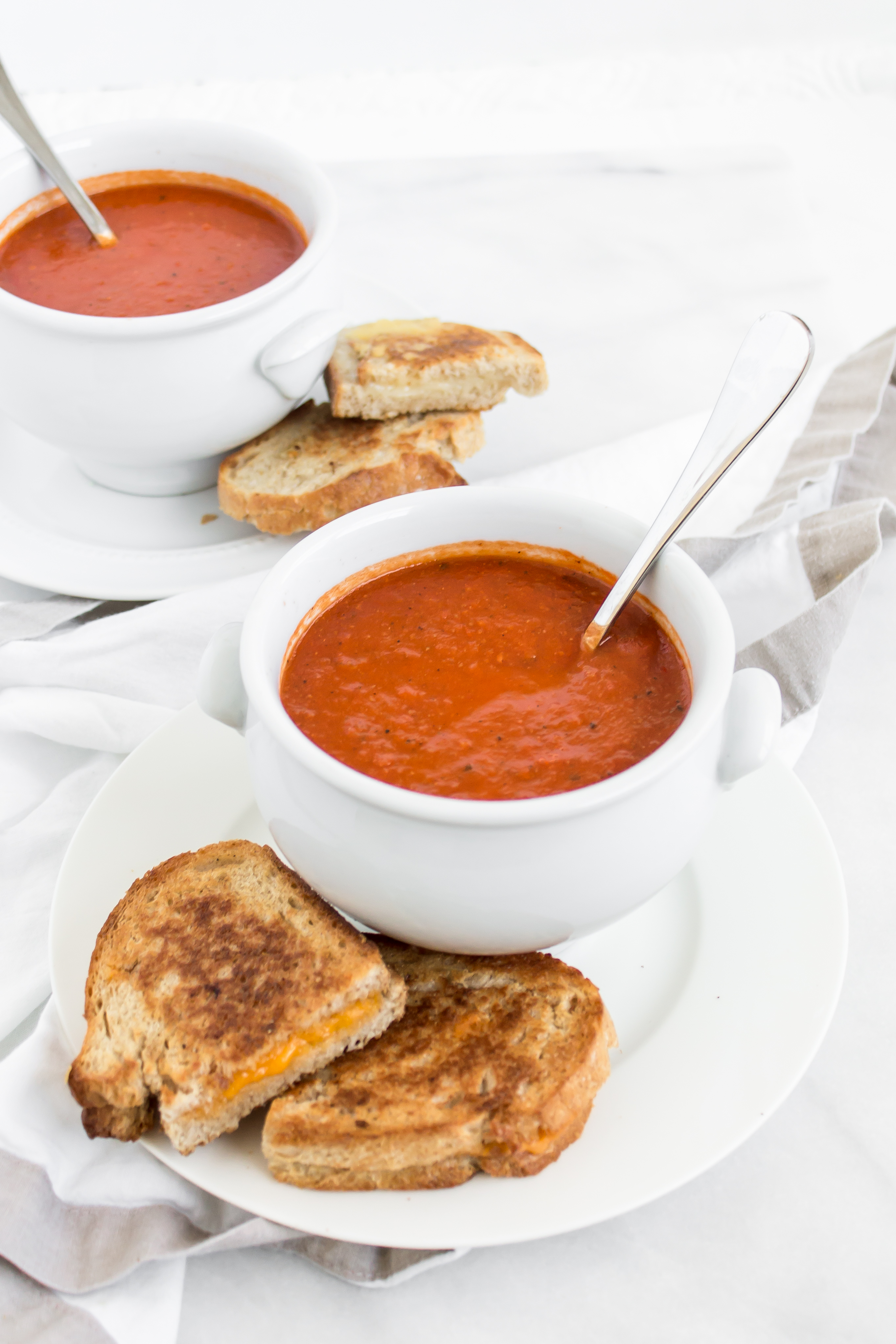 Looking for an easy and delicious healthier soup for dinner? You'll love this spin on classic tomato soup. It's dairy-free using one very cool secret ingredient that keeps it healthier and protein-packed. Click through for the recipe. | glitterinc.com | @glitterinc - Healthier Protein-Packed Classic Tomato Soup by popular North Carolina foodie blogger Glitter, Inc.