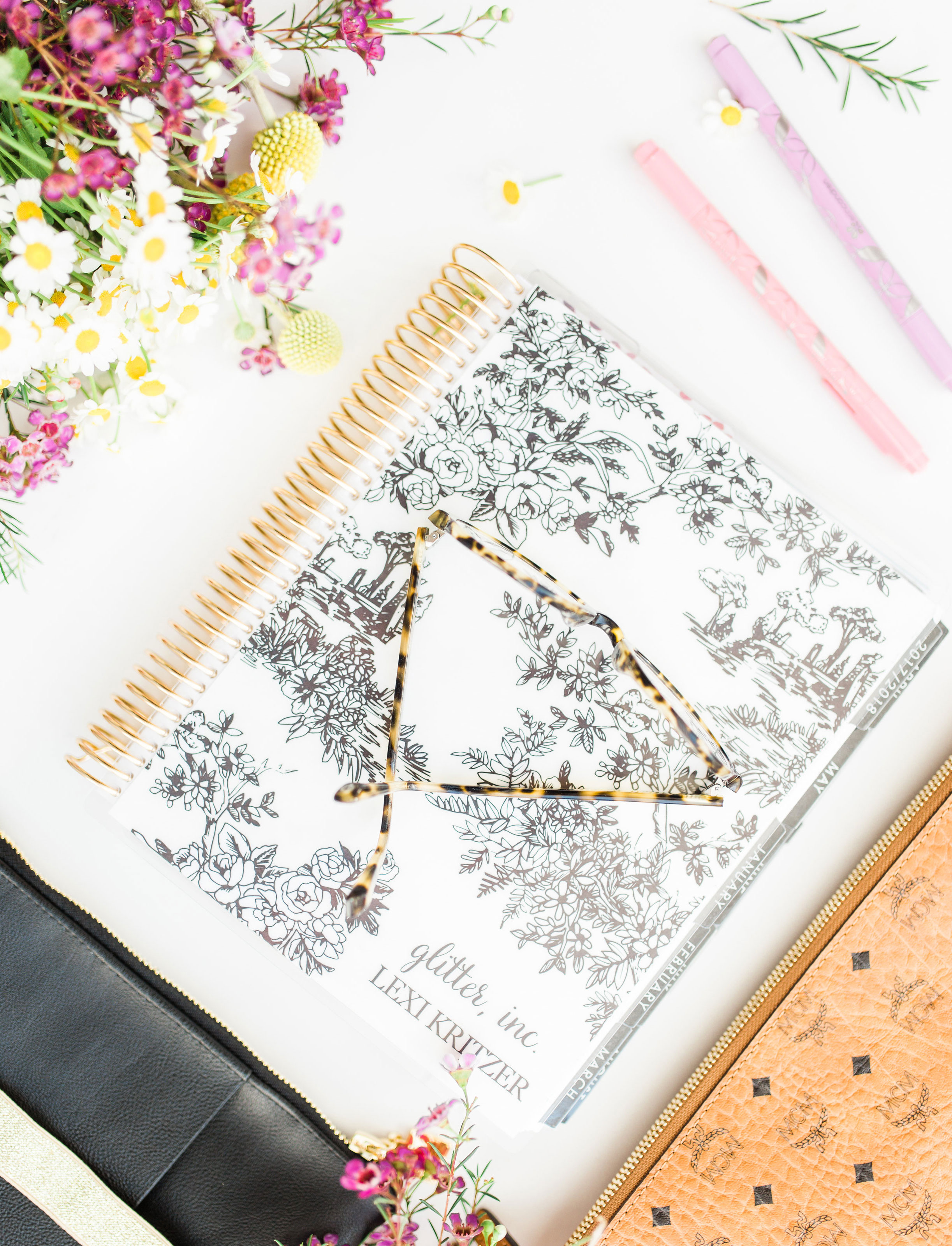Looking for the perfect paper planner? I'm sharing how I plan and stay organized with my Erin Condren LifePlanner, plus all of the best accessories and cutest stickers. #lifeplanner #erincondren #agenda | glitterinc.com | @glitterinc