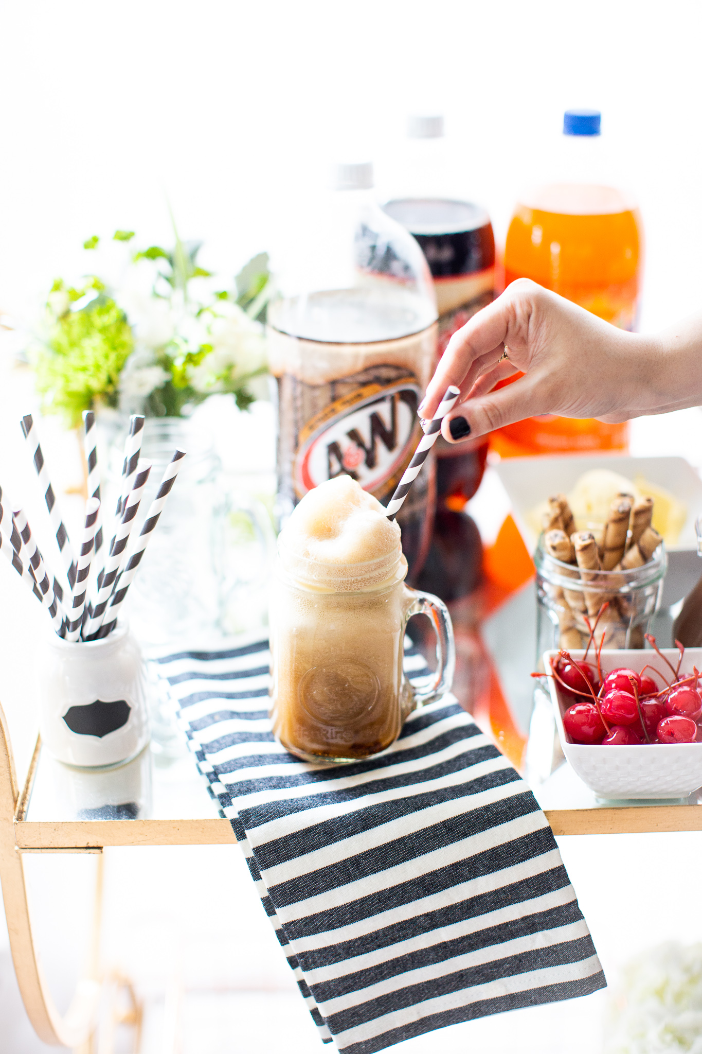 Ready to celebrate family night in a whole new way? Make your own root beer float bar with all of the best toppings, for a legendary sweet treat! | glitterinc.com | @glitterinc