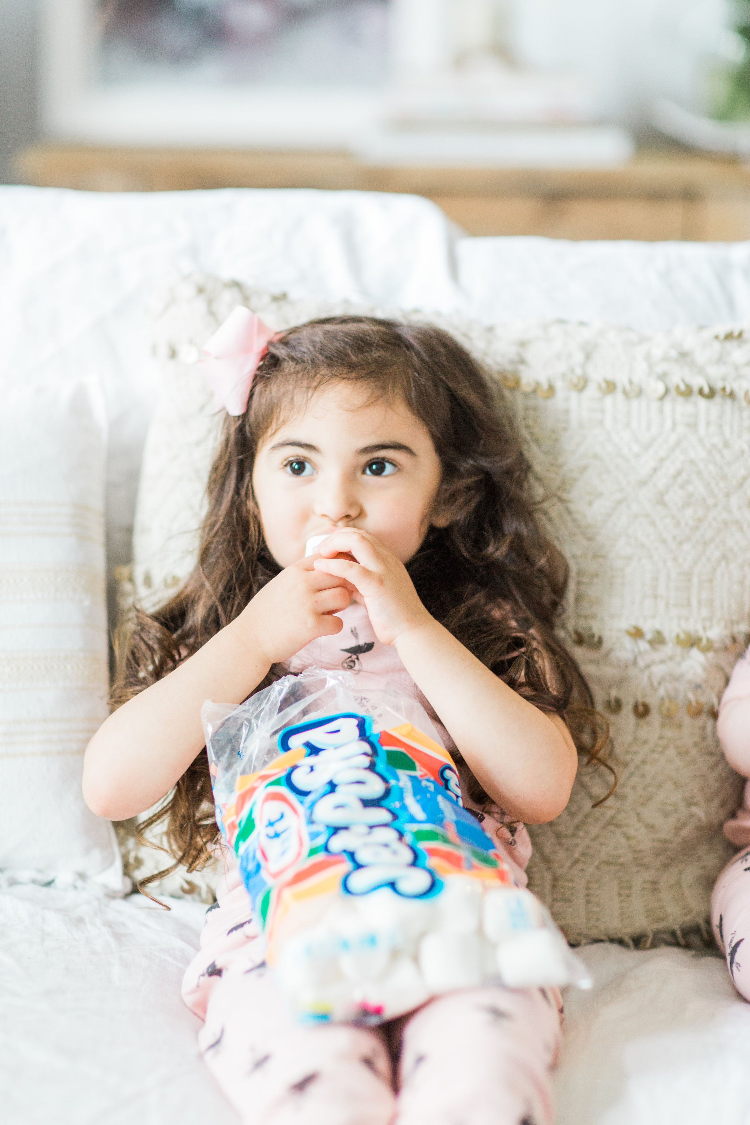 I'm sharing a big 'ol dose of cuteness; a.k.a., the behind-the-scenes of the girls trying s'mores for the first time (and caught on camera) from our family movie night! #smores #matchingpajamas #movienight #familyfun #smoresparty   glitterinc.com   @glitterinc