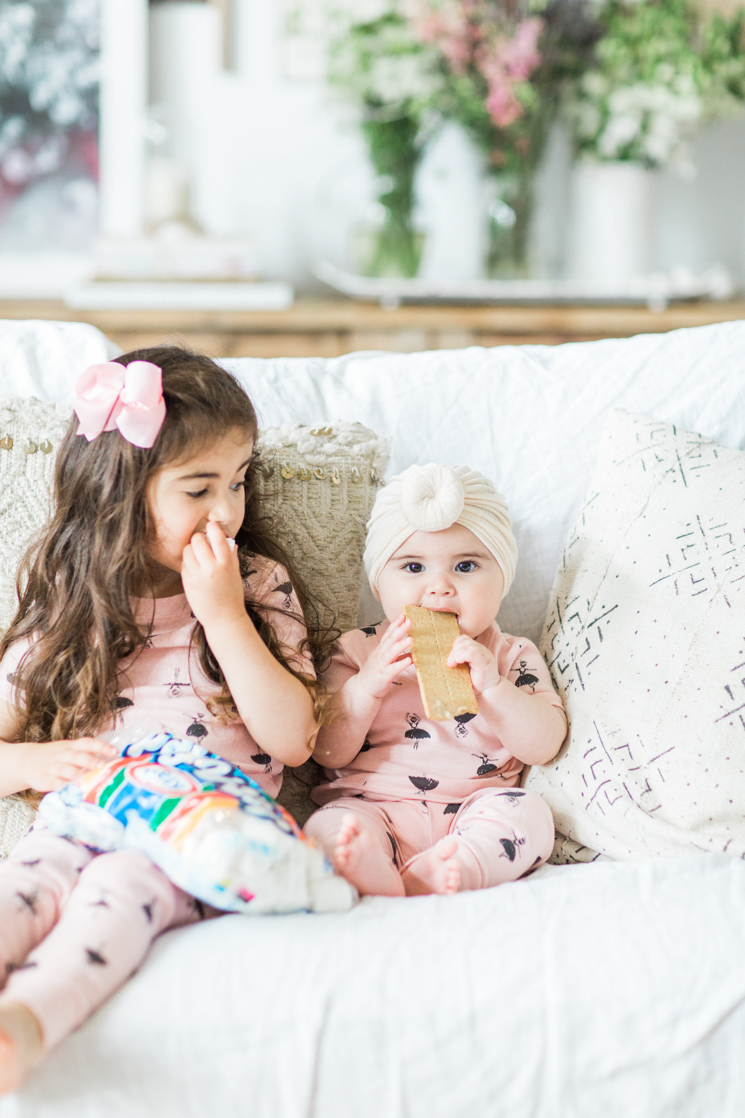 I'm sharing a big 'ol dose of cuteness; a.k.a., the behind-the-scenes of the girls trying s'mores for the first time (and caught on camera) from our family movie night! #smores #matchingpajamas #movienight #familyfun #smoresparty | glitterinc.com | @glitterinc