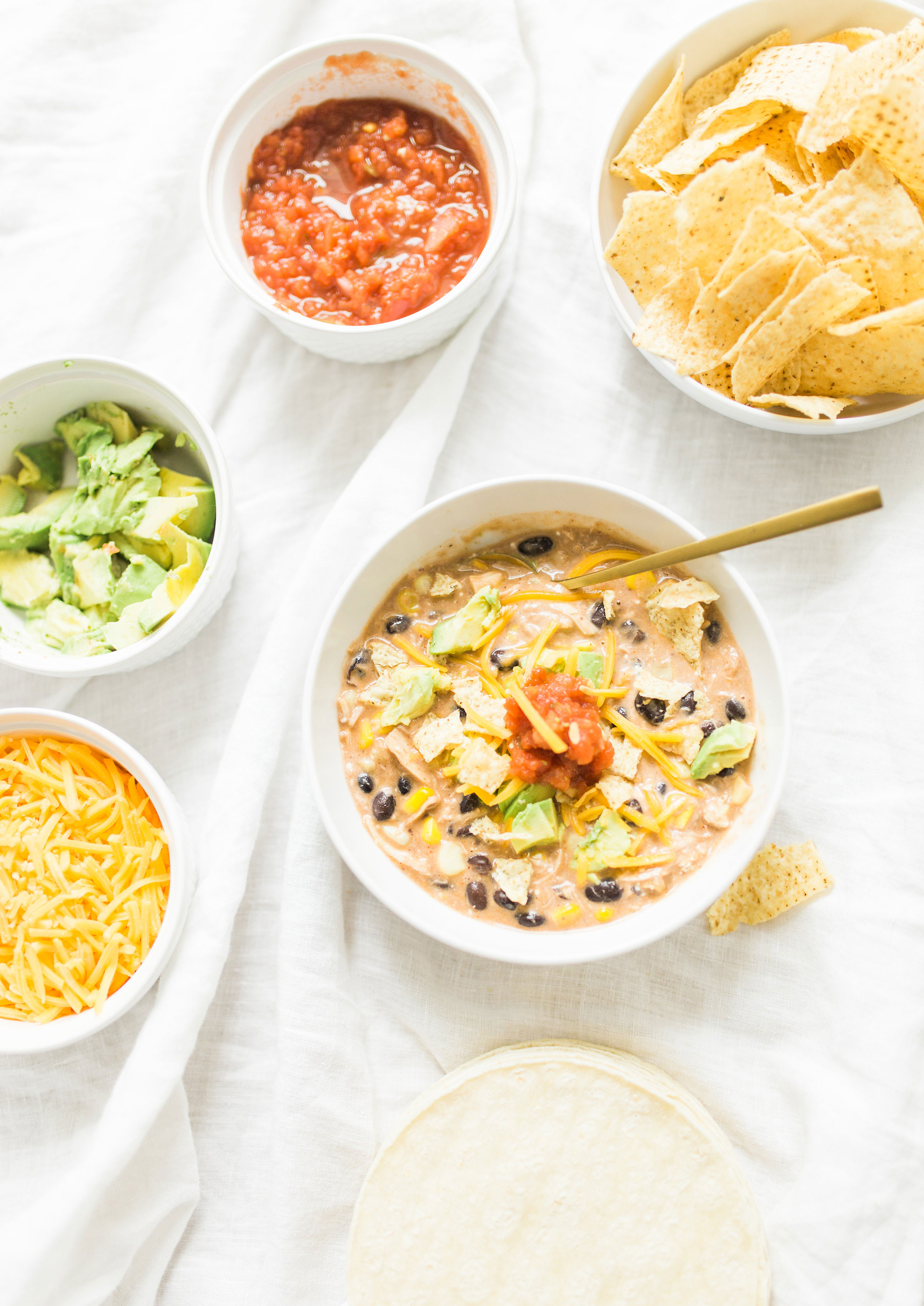 This easy and delicious creamy chicken enchilada soup is made in a crockpot or Instant Pot - a.k.a., dump it and forget it. Our whole family loves it. #crockpot #crockpotmeals #crockpotdinner #instantpot #instantpotdinner #instantpotchicken #crockpotchicken #chickenenchiladas #crockpotenchiladas #instantpotenchiladas #slowcooker #slowcookersoup #slowcookerenchiladas #slowcookermeals Click through for the recipe. | glitterinc.com | @glitterinc